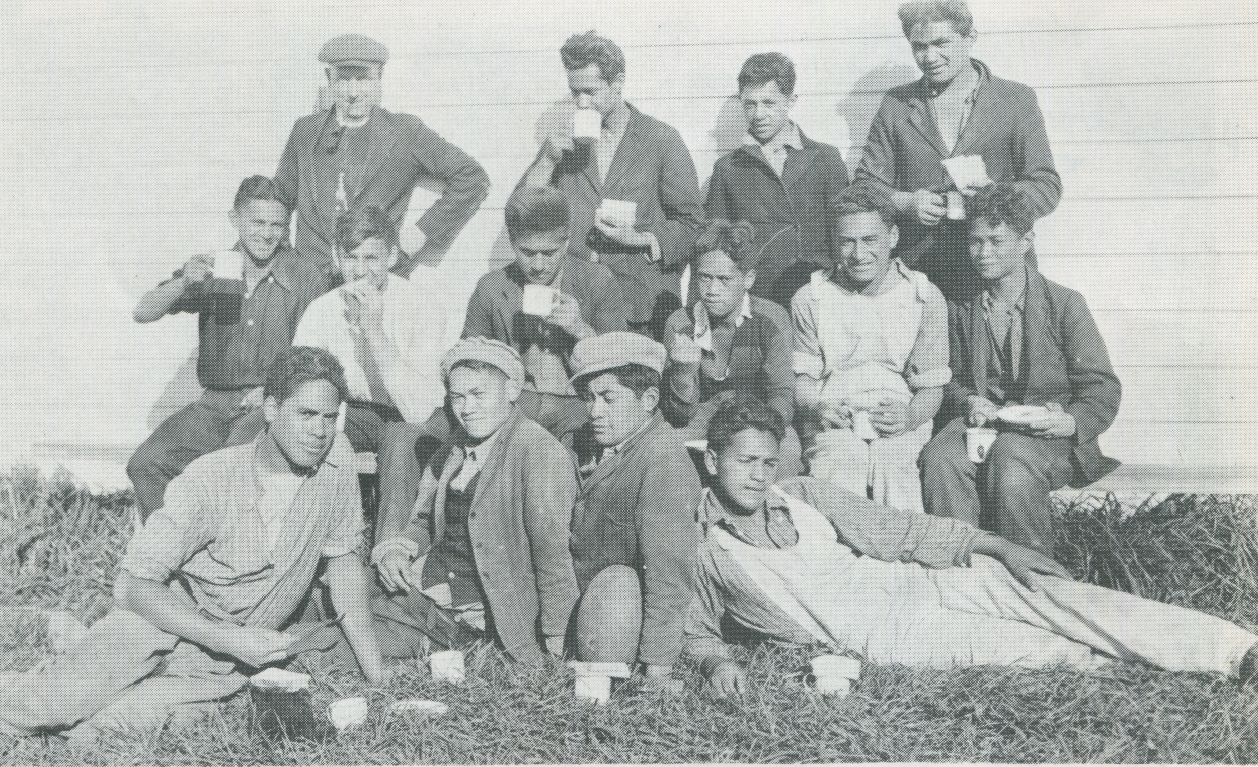 Students taking a break while working on the fields around their school. Image credit: Rangi Davis. 1930.
