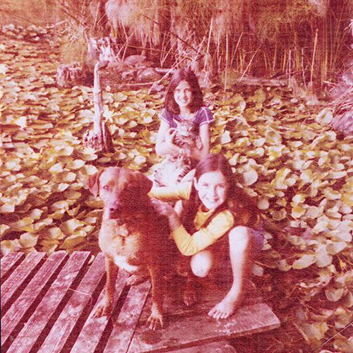 Lake Pupuke. Angela holding spiggles and Rachael holding Brandy. Angela Te Wiata. 1978.