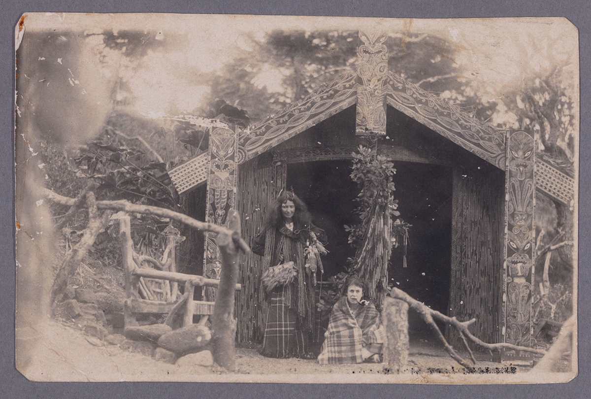 Postcard with Mary Ann Wick and child in their garden at 10 Brett Ave. Mary Ann Wick (Angela's great, great grandmother) purchased this land from Henry Lloyd Brett (after whom Brett Ave is named) in 1905. Image credit: Angela Te Wiata. Early 1900s.