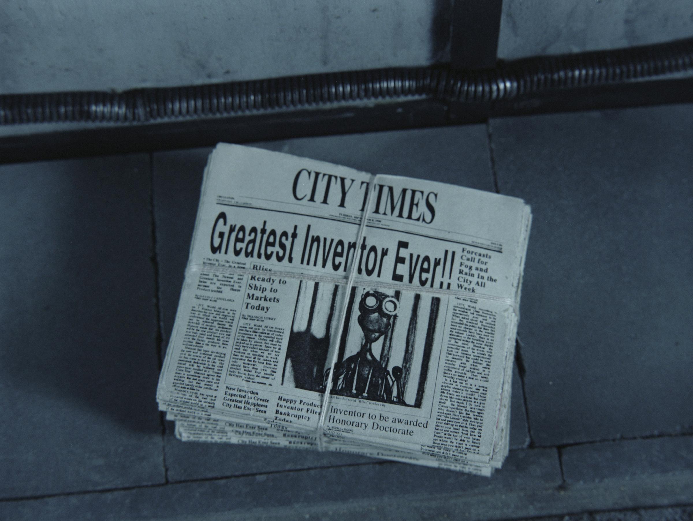 MORE_stills_013_newspapers.jpg