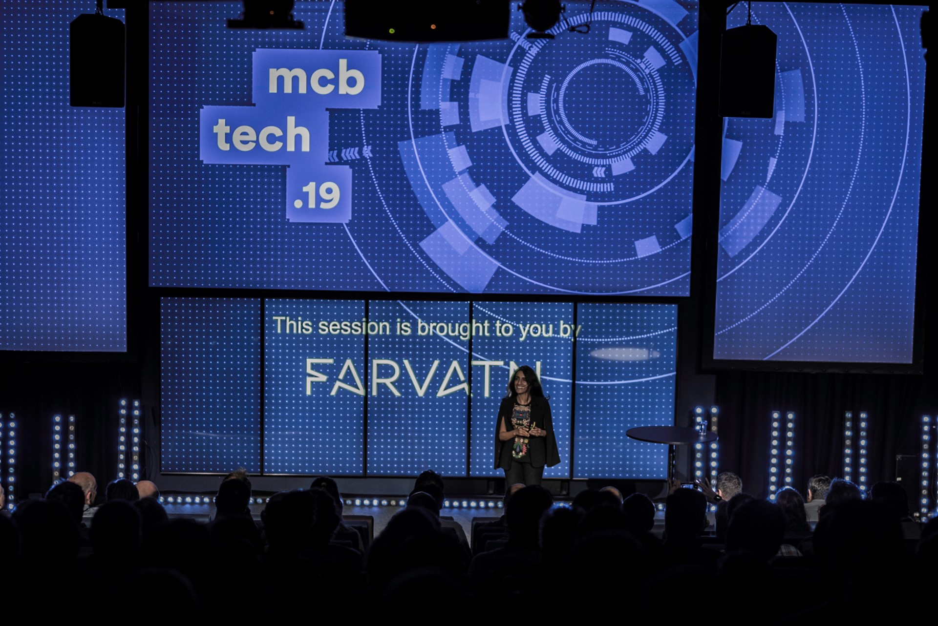 Dr Ayesha Khanna on stage at mcb tech, presenting Thriving in the Emerging Human-Technology Civilization