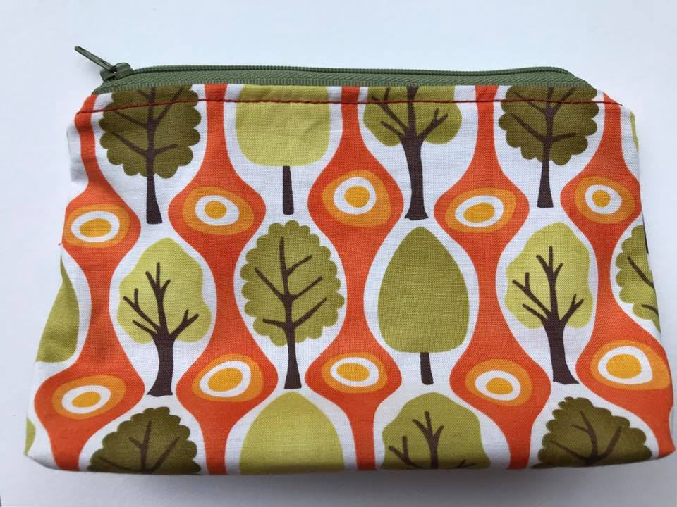 "5. Handcrafted zippered pouch (front) and (back) the same. Approx. 4 1/2"" x 8"""
