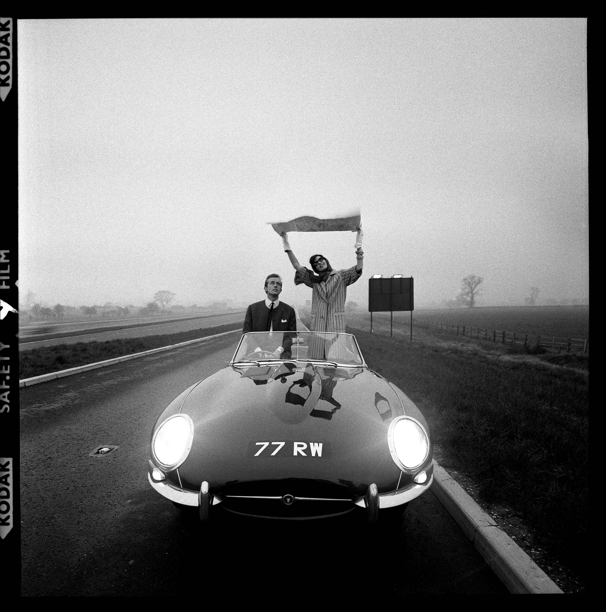 E-type Jaguar on the M1 Motorway, soon after it opened for Vogue Magazine, 1960