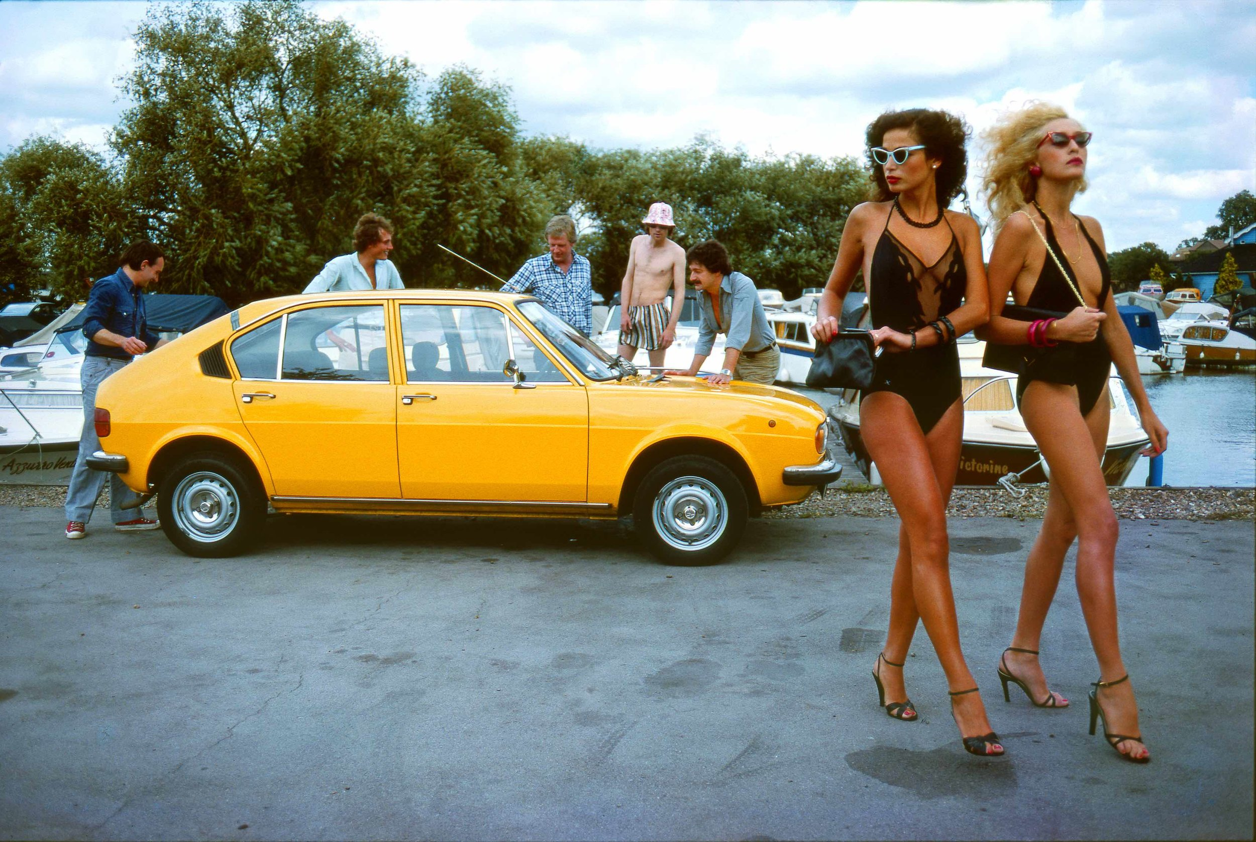 Jerry Hall, (possibly Bianca Jagger) & an Alpha Sud, Henley on Thames, Fashion Shoot for the Telegraph Magazine, 1974