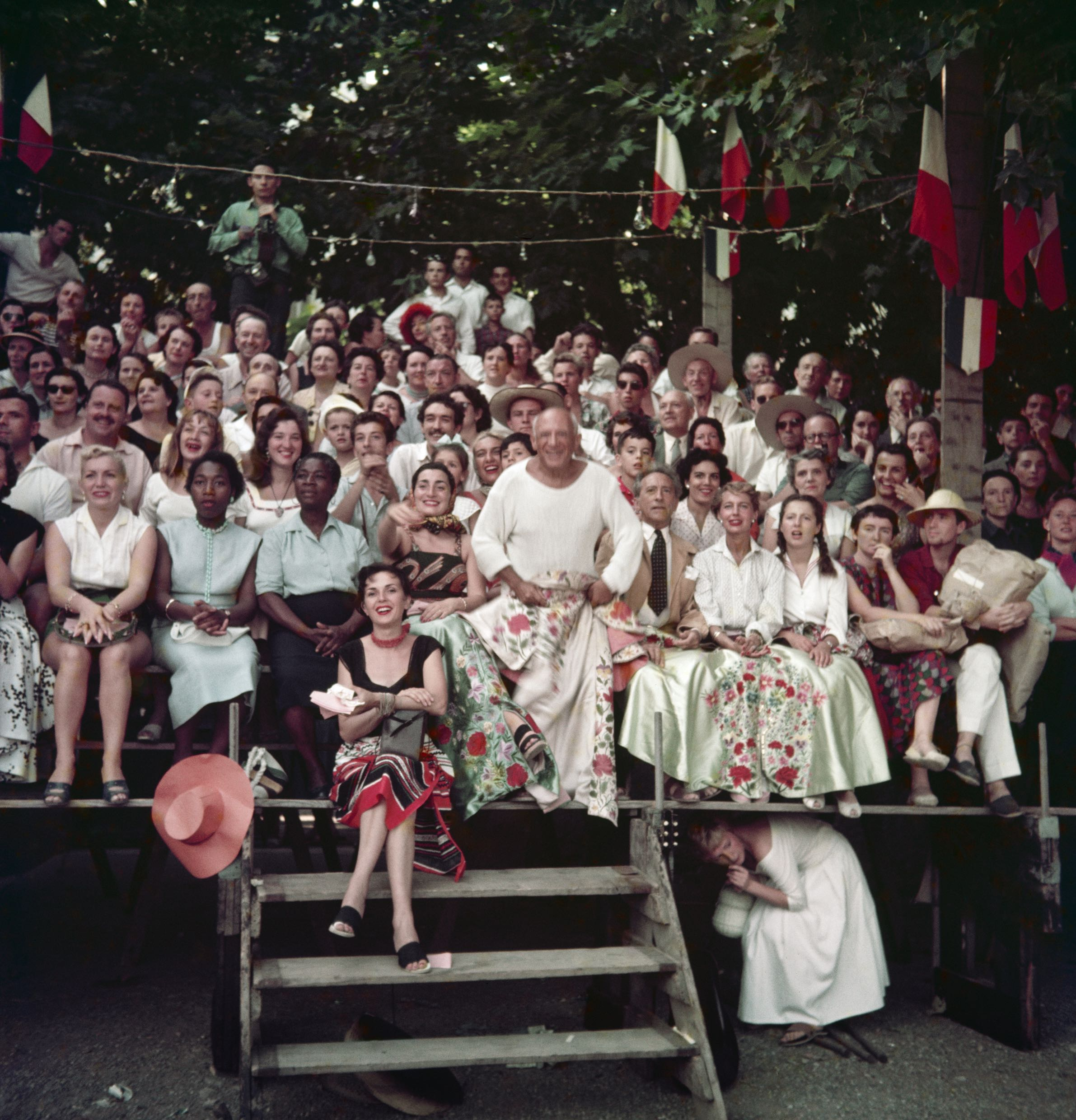 Jacqueline Roque & Picasso, Jean Cocteau, Francine & Carole Weisweiller & sitting in front Florette at the Bullfight, Vallauris, 1955