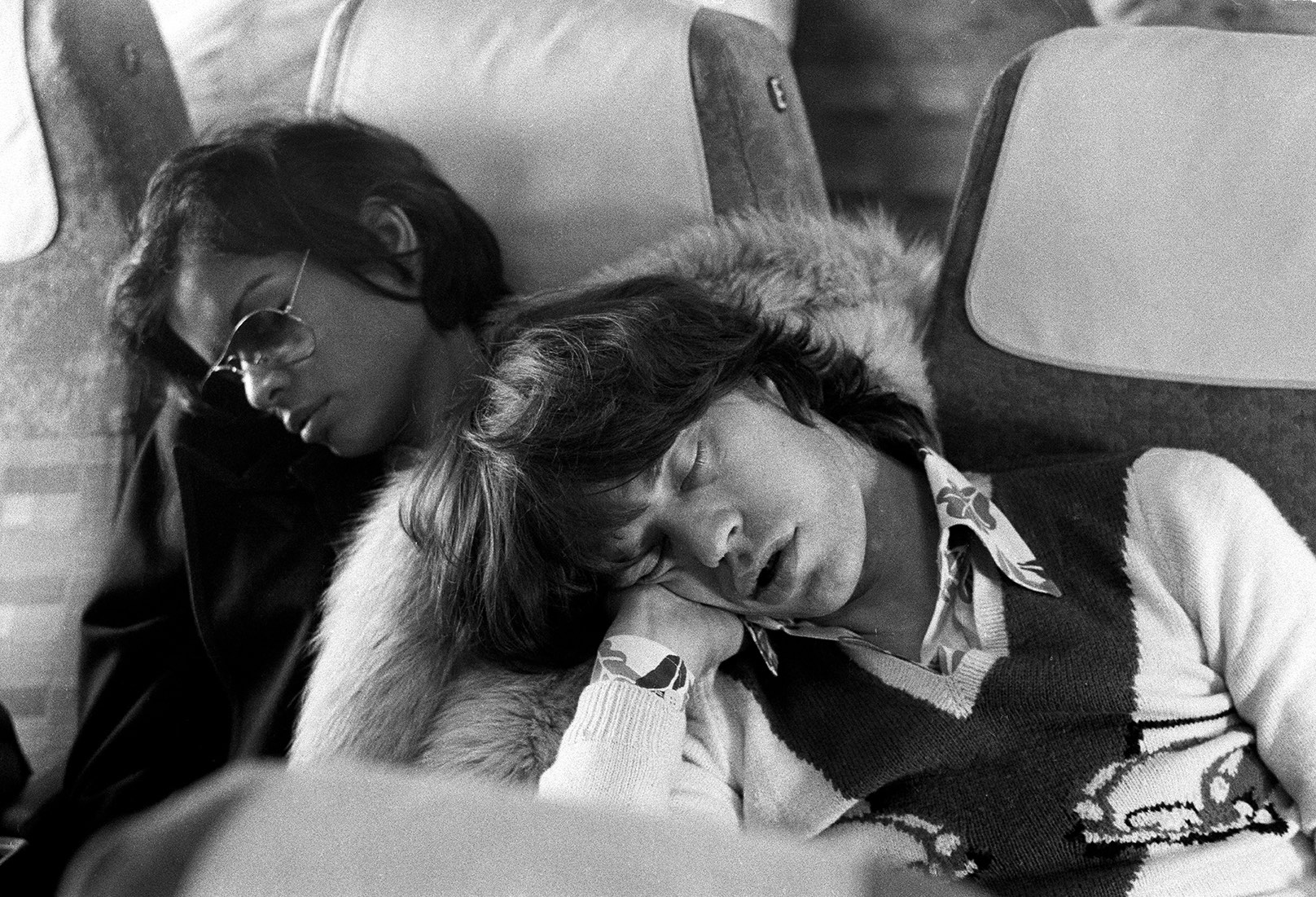 Mick & Bianca asleep on plane after the Last Night Party of 1973 European Tour, 1973