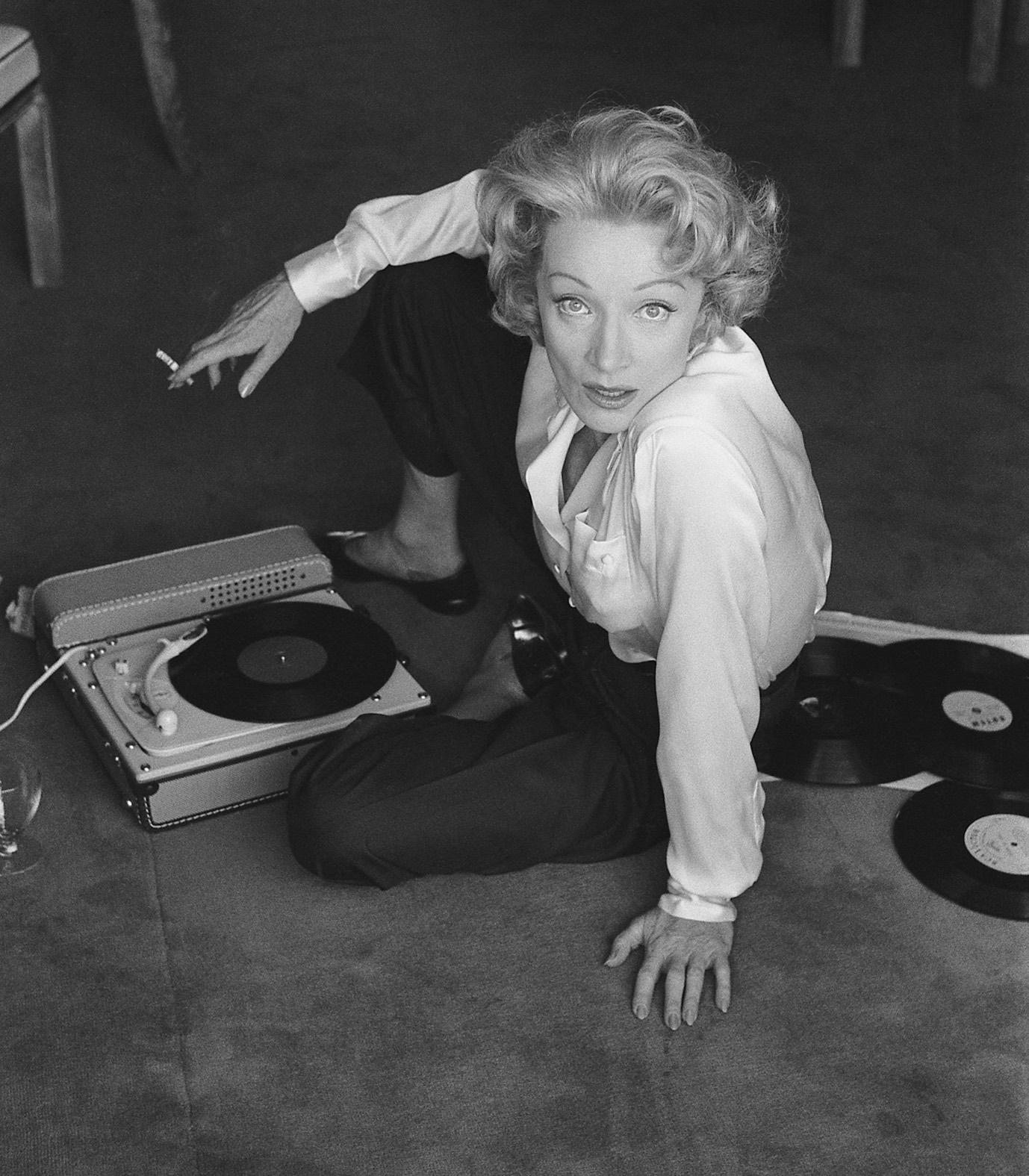 Marlène Dietrich with Record Player, L'hotel de Paris, Monte Carlo, 1956