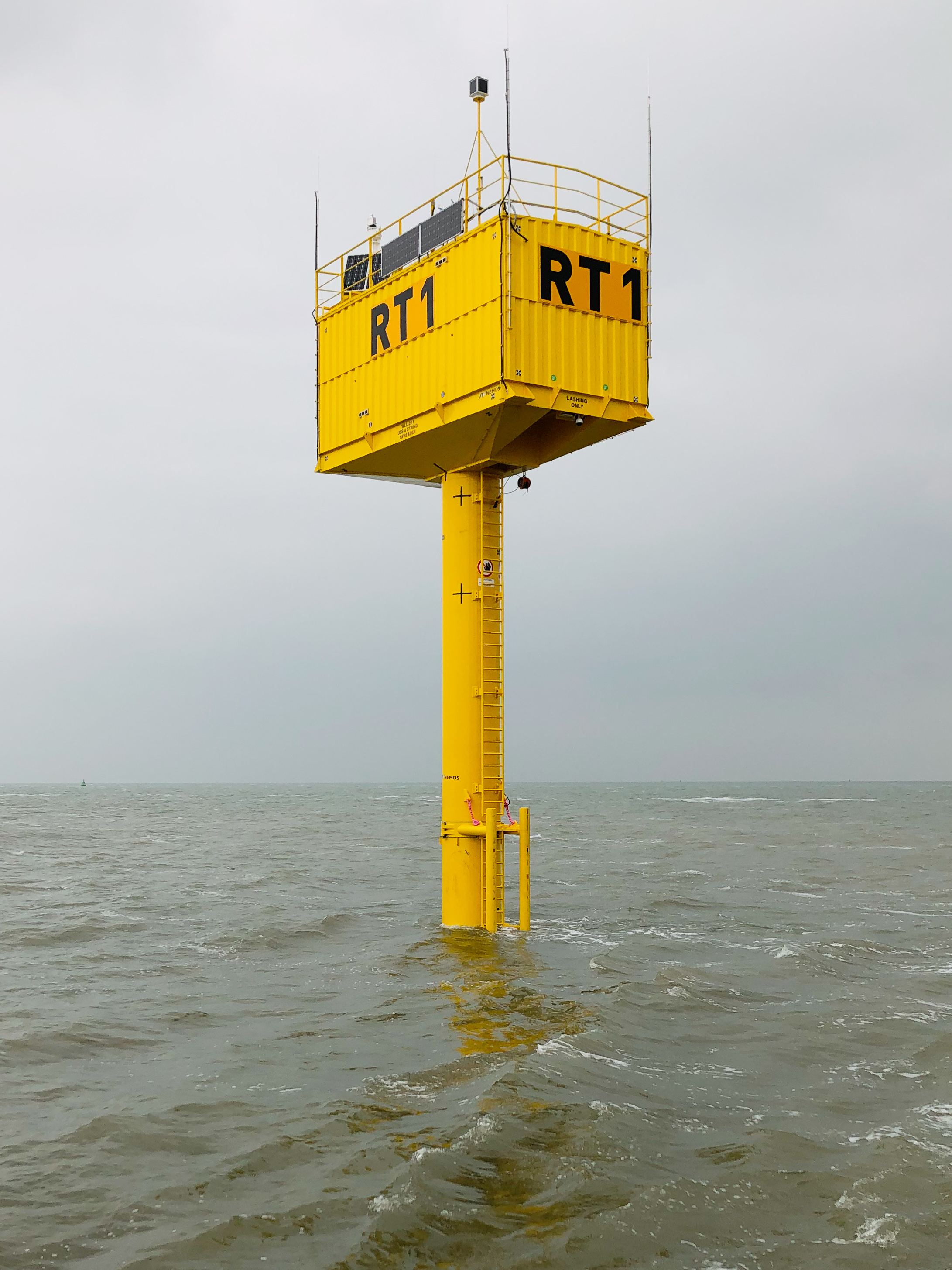 - NEMOS is delighted to announce the completion of the installation and commissioning works for the Ostend Research Tower, located 500m off the coast of Oostende. Last week, the final secondary steel components and topside research container were installed by HERBOSCH-KIERE with the support of DECO and NOORDZEE KRANEN. In addition, the research area east to the tower was marked with buoys by VLOOT in preparation for the installation of the 2019 NEMOS Wave Energy Converter (WEC) Prototype.The final commissioning works at the PORT OF OOSTENDE was coordinated by NEMOS and utilised several local companies. NEMOS would like to thank the participants for the experienced, professional support received. Special thanks go to IDP SHIPJARD, MULTITECH, ENGIE FABRICOM and the PORT OF OOSTENDE.NEMOS is now looking forward to the transfer of ownership of the Research Tower infrastructure to the West Flanders Development Agency – POM West-Vlaanderen. The maritime platform will then serve as a laboratory, used to perform tests designed to accelerate the innovation and development of blue energy and the broader blue economy. As one of the first key users, NEMOS will use the Research Tower as a control and monitoring hub for WEC trials this summer.- - -NEMOS is verheugd om de afronding van de installatiewerken en de ingebruikname van de Ostend Research Tower mee te delen. In de afgelopen dagen zijn de secundaire staalcomponenten en het bovenste onderzoeksplatform geïnstalleerd door HERBOSCH-KIERE met de steun van DECO en NOORDZEE KRANEN. Simultaan aan deze installatiewerken is het onderzoeksgebied ten oosten van de toren gemarkeerd met boeien door VLOOT. Dit ter voorbereiding op de installatie van het afmeersysteem voor de 2019 NEMOS Wave Energy Converter (WEC) Prototype.Na een aantal intensieve weken met werken rond de inbedrijfstelling in de PORT OF OOSTENDE zou NEMOS graag zijn dank uiten aan de deelnemende lokale bedrijven en agentschappen voor de geweldige en professionele ondersteuning. Deze dank gaat voornamelijk uit naar IDP SHIPJARD, MULTITECH, ENGIE FABRICOM en PORT OF OOSTENDE.Momenteel kijkt NEMOS uit naar de overdracht van de eigendomsrechten van de infrastructuur van de onderzoekstoren aan de West-Vlaamse onderzoek agentschap – POM West-Vlaanderen. Volgens POM zal het maritieme platform dienen als een 'living lab' om testen uit te voeren om de innovatie en ontwikkeling van blauwe energie en de bredere blauwe economie te versnellen. Als één van de eerste belangrijke gebruikers zal NEMOS de onderzoekstoren gebruiken als het besturings- en monitoringcentrum voor de WEC-tests die deze zomer van start gaan.Pictures: https://www.nemos.org/rt1media