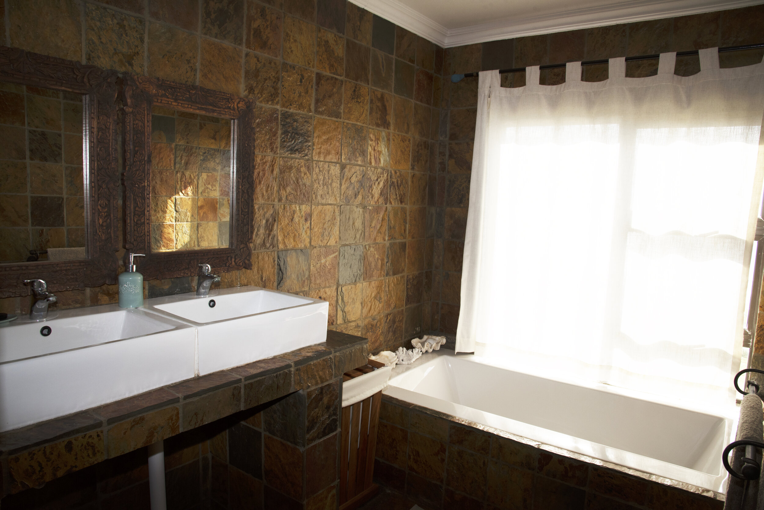 Bathrooms - The en-suite bathrooms have a shower or a bath-tub to relax in. His and Her's sinks accompanied by the exquisite vanity mirrors. The bathrooms includes bath towels set, with your basic toiletries.