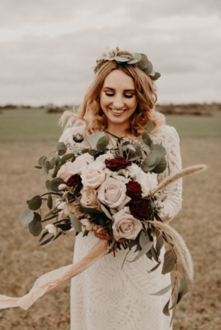 Boho Wedding flowers at Lodge Farm Barns, Essex.  Photograph by Kelsie Low