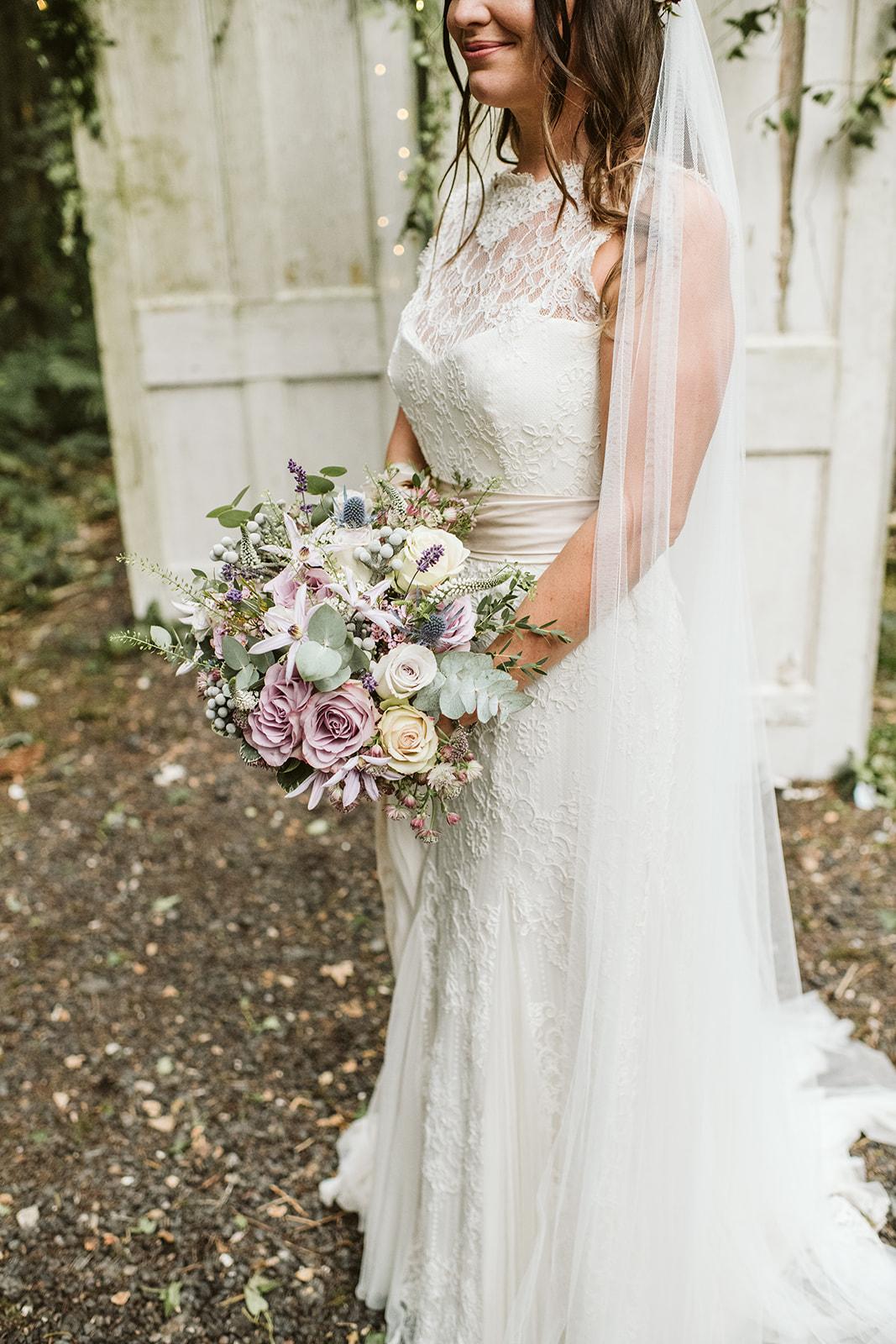 Wild, bridal wedding bouquet by boho wedding florist Velvet Rose Flower Studio in Essex