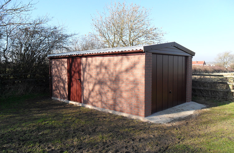 This garage was built with a red brick effect finish. This service does require a 1 metre access around the building, but is available in a selection of colours.