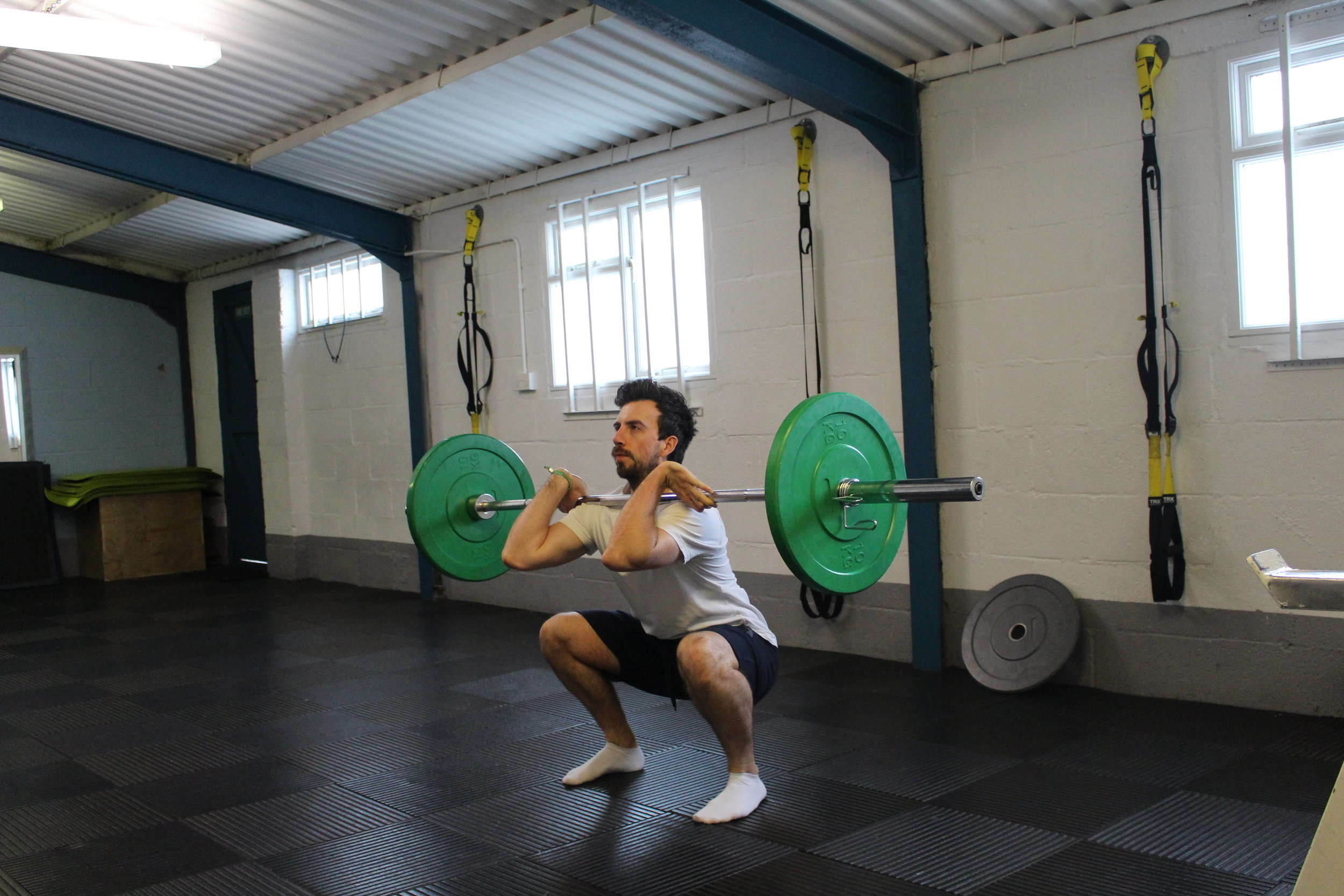 Dan, a frome-based personal trainer, exercises with a barbell in the studio.