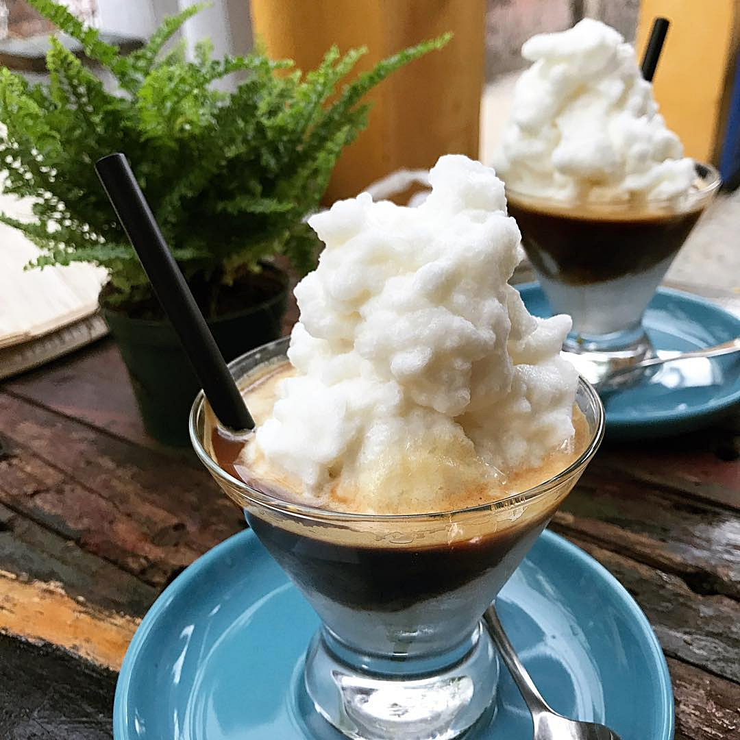 coconut coffee -  Coconut cream blended with condensed milk and ice, topped with espresso.