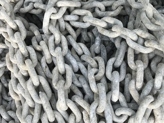 Weathered anchor chain at the marina in Croatia