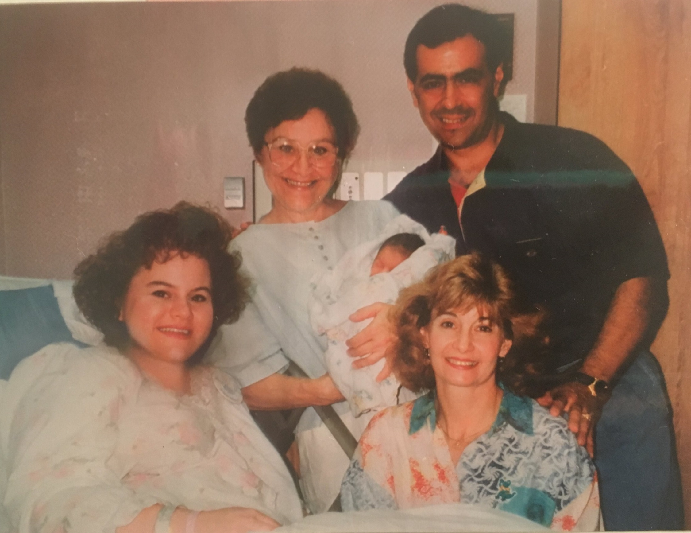 Torie and her family in the hospital after she was born