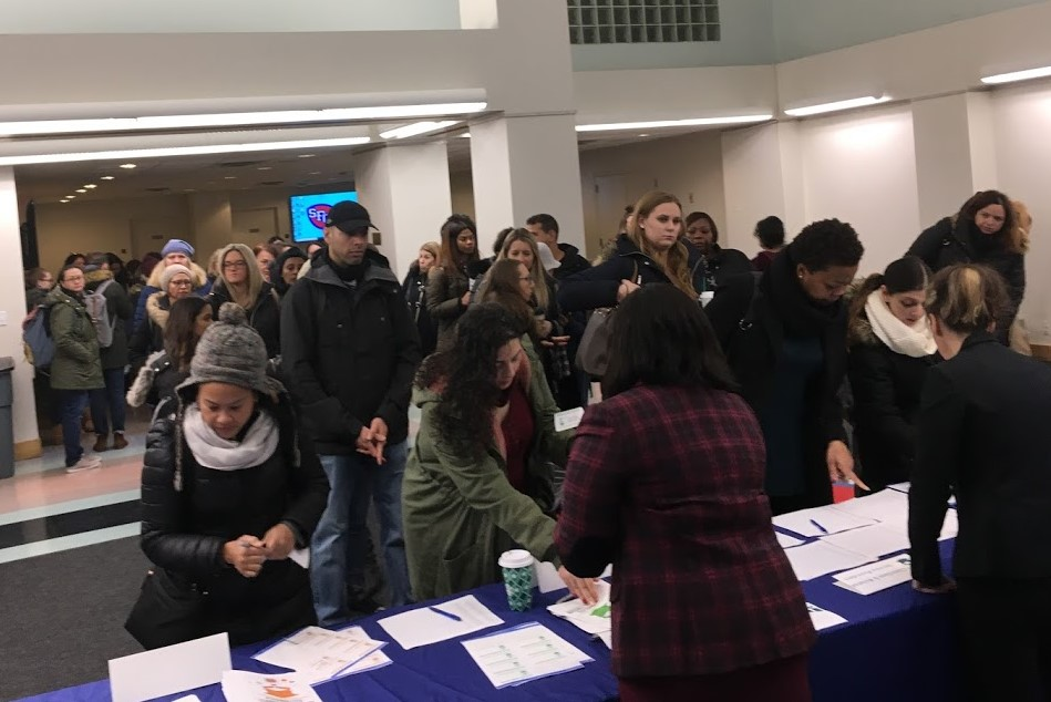 Pictured: Teachers, therapists, and service providers line up to register for the Personalized Learning Symposium on January 4, 2019 that targets staff in gifted/accelerated schools and programs who serve students with disabilities.