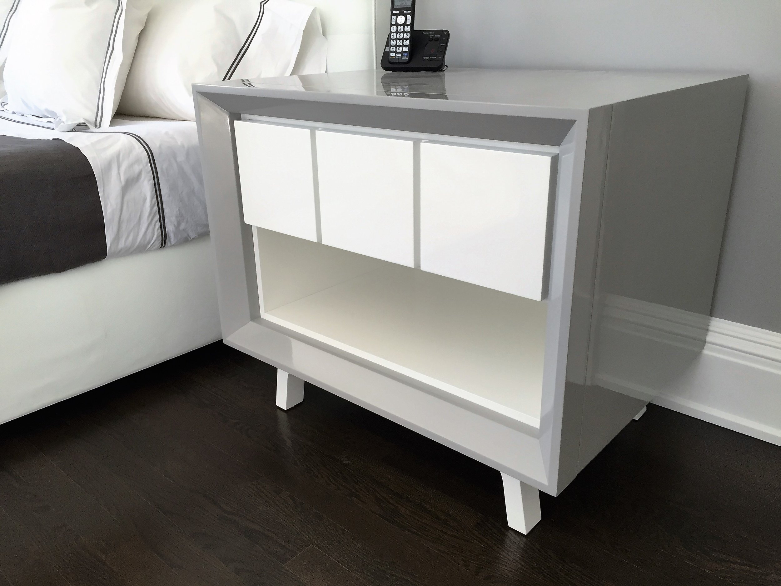 Modern bedside table, high gloss grey and white.