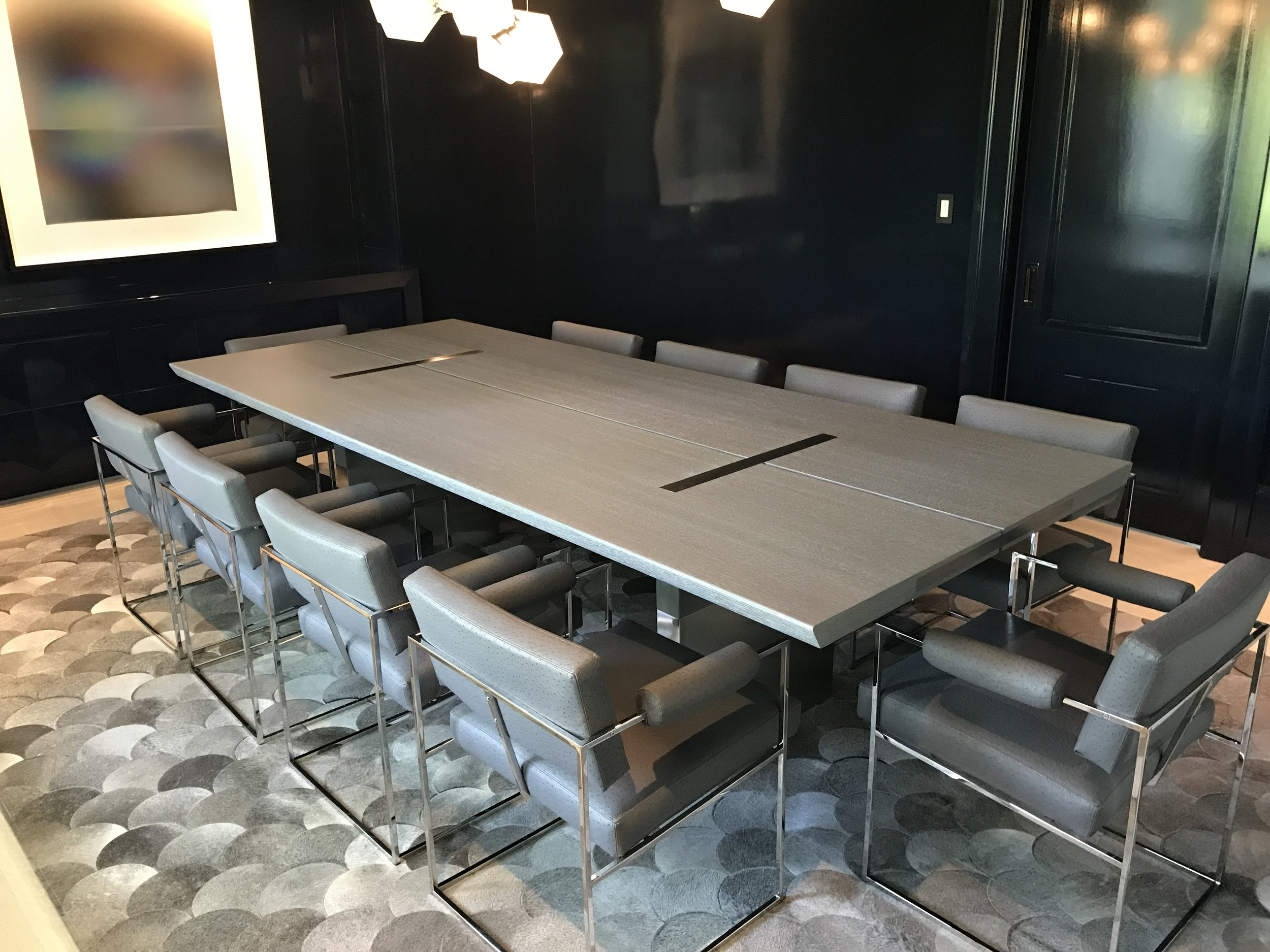 Gray stained white oak with stainless steel inlays and legs.