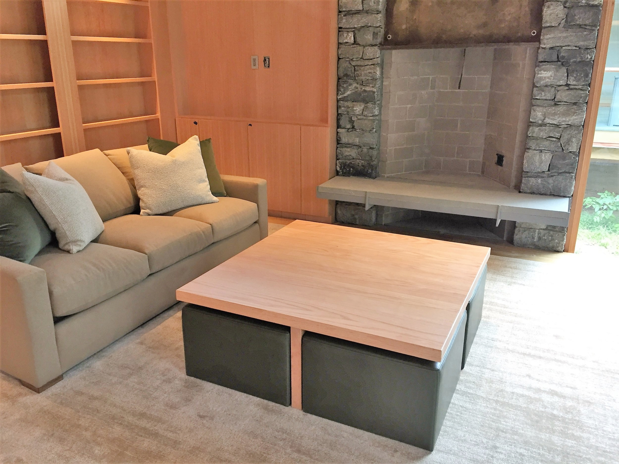 Red oak coffee table with seating under.