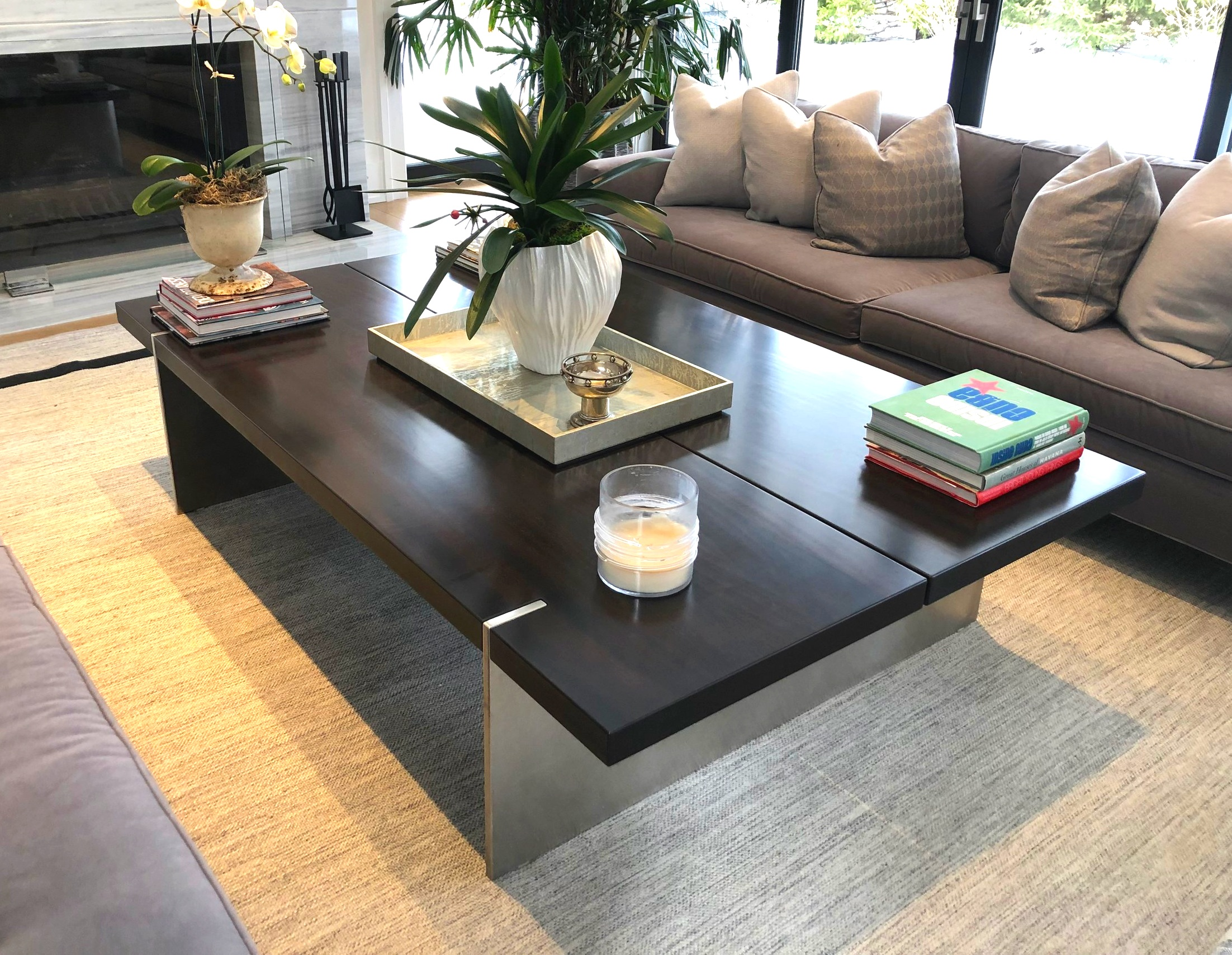 Mahogany split top coffee table with solid stainless steel legs