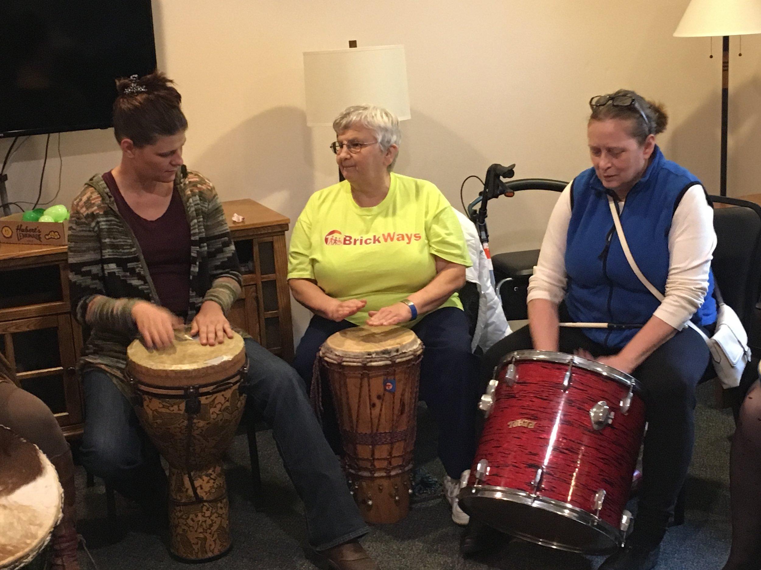 Susan Wilson, Amy and Rose drumming.jpg
