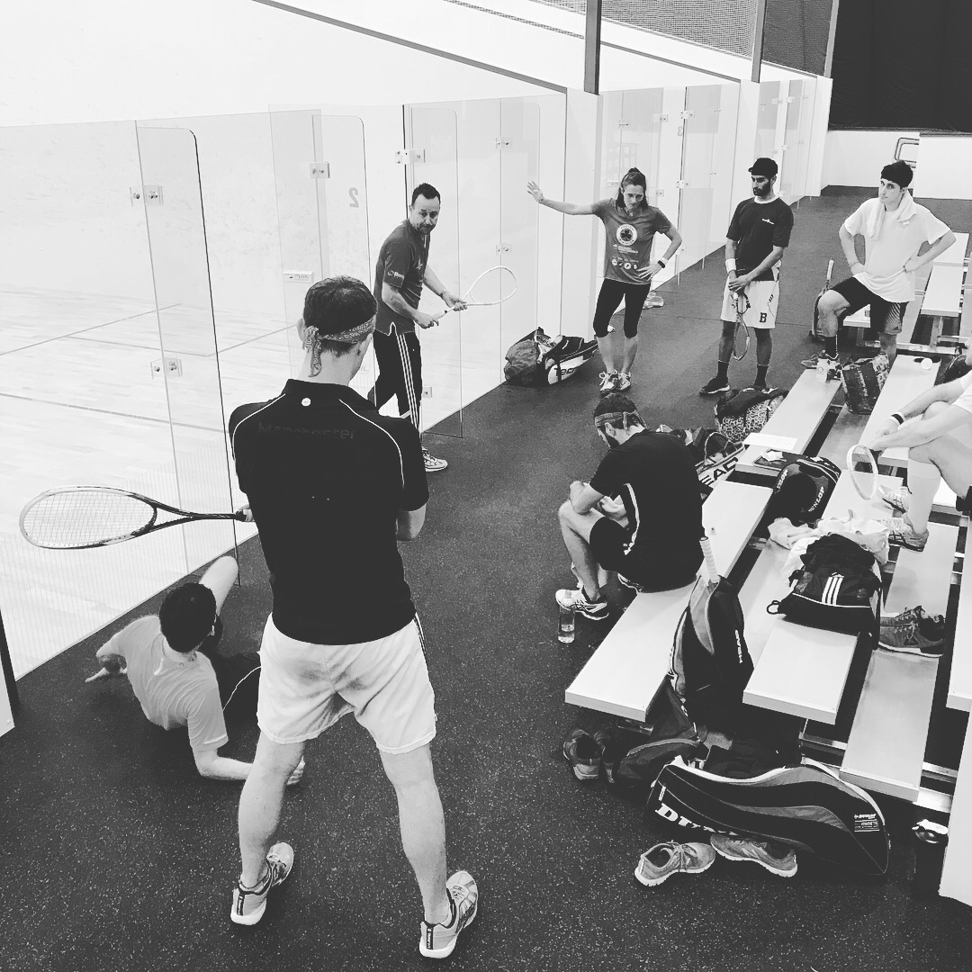 Nick Taylor giving further instruction to a group of squash athletes