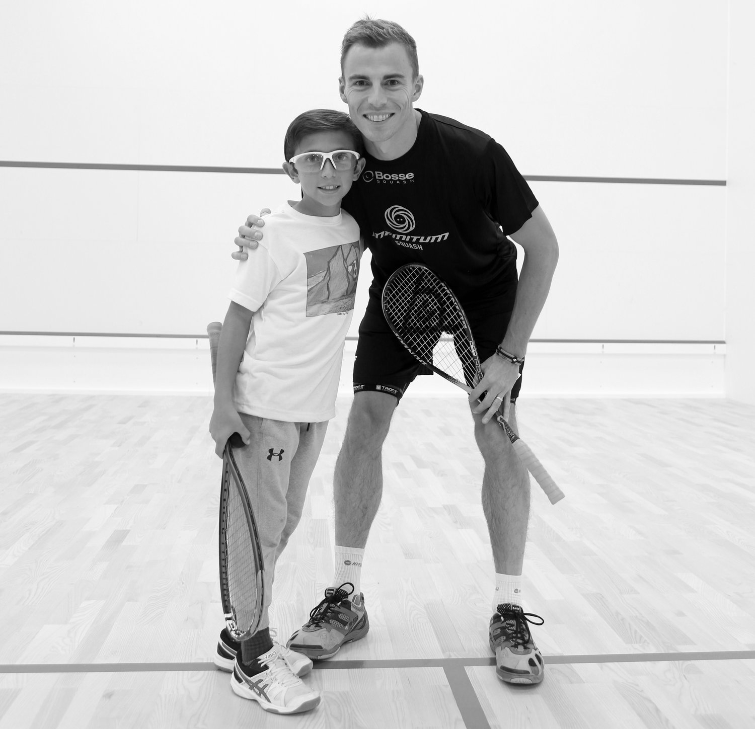 INFINITUM Squash Junior Academy player, Max Crowe. Pictured here at the INFINITUM Squash Opening Exhibition in October with 3X World Champion, Nick Matthew.