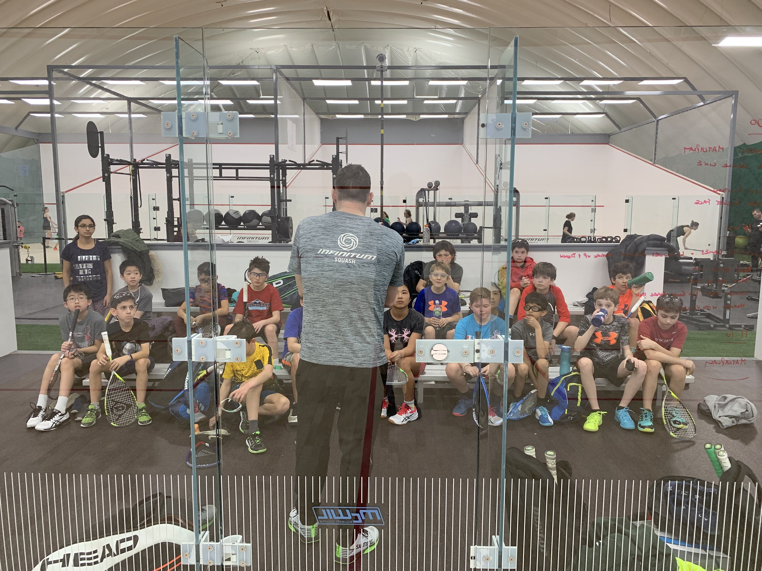 infinitum squash junior clinics.jpeg
