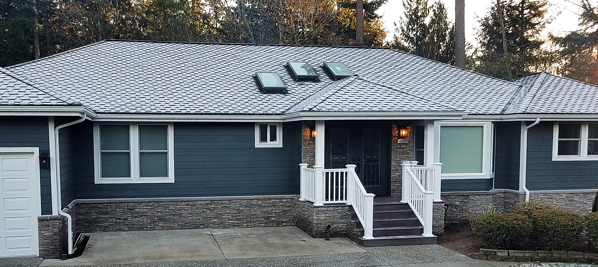 Pictured: James Hardie Fiber Cement Color Plus Siding (color: Iron Gray)
