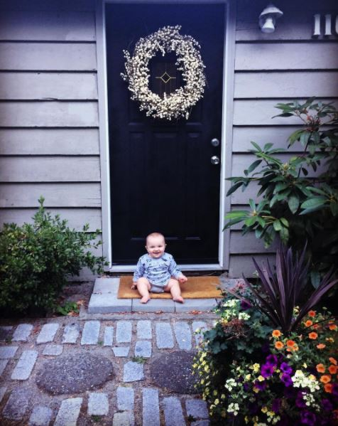 An oldie but a goodie — my son a couple years back in front of our fresh black door.