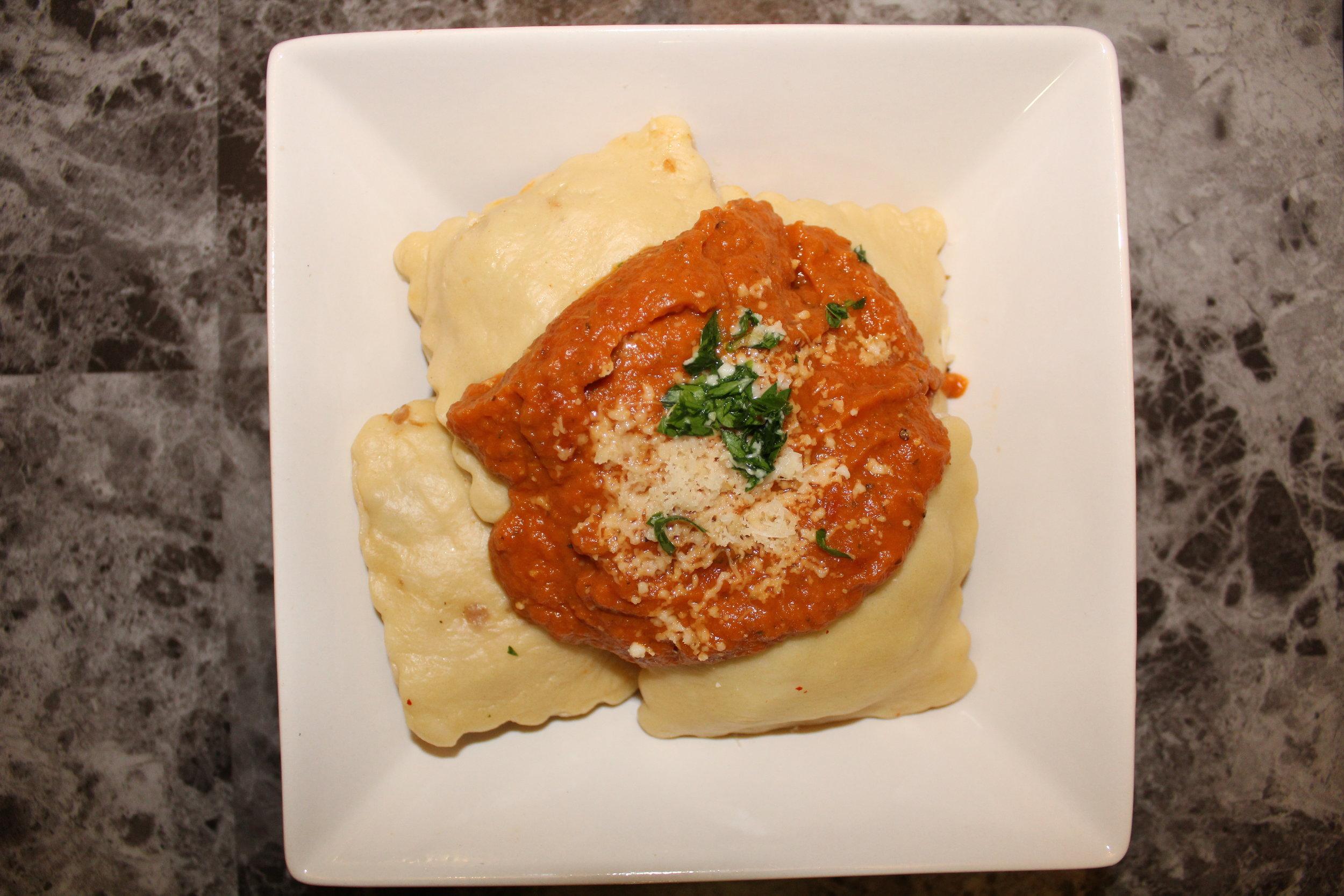 Spicy chicken sausage ravioli with