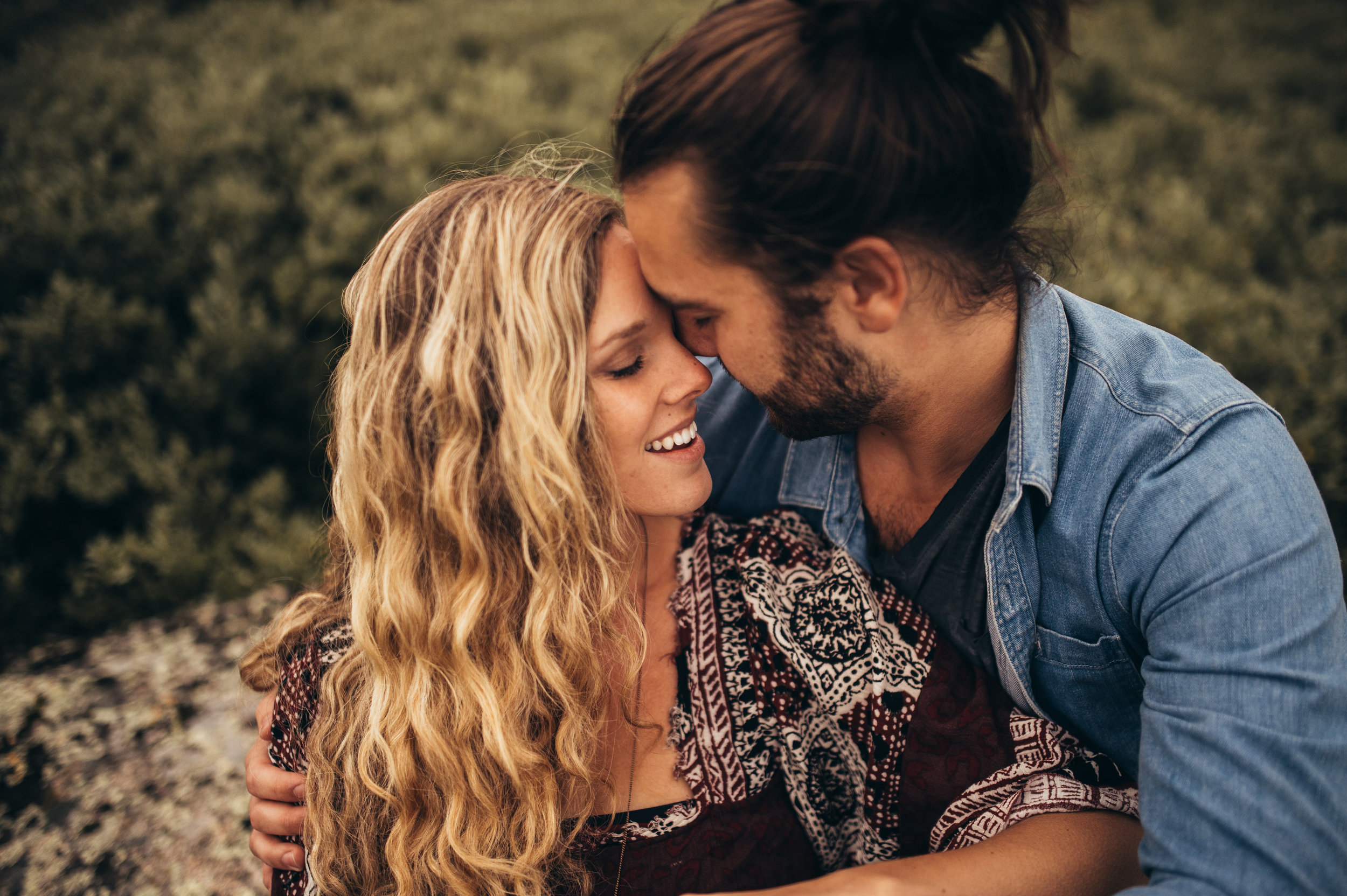 Husband and wife joyfully embracing.