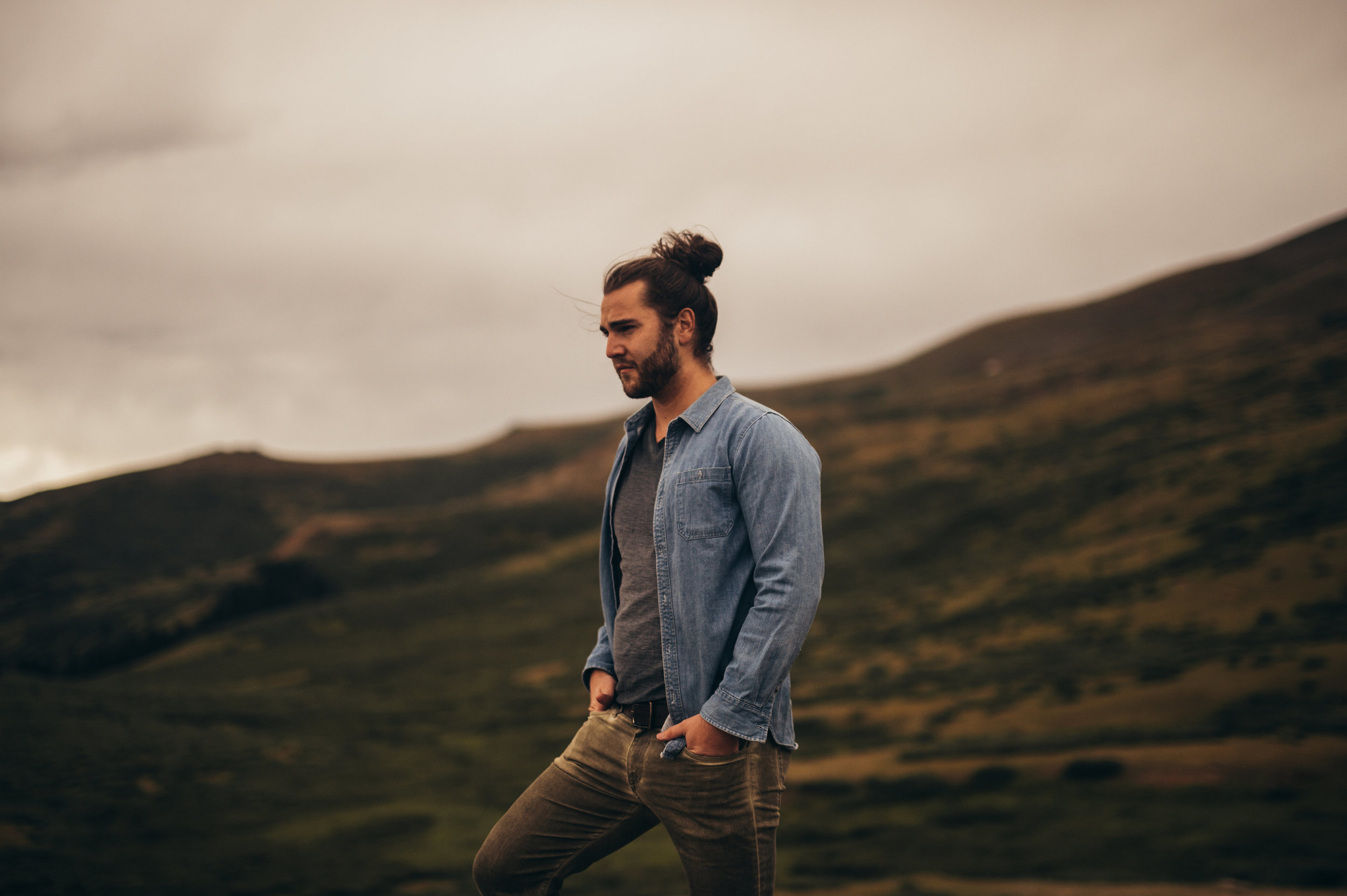 Man standing on rock in mountain