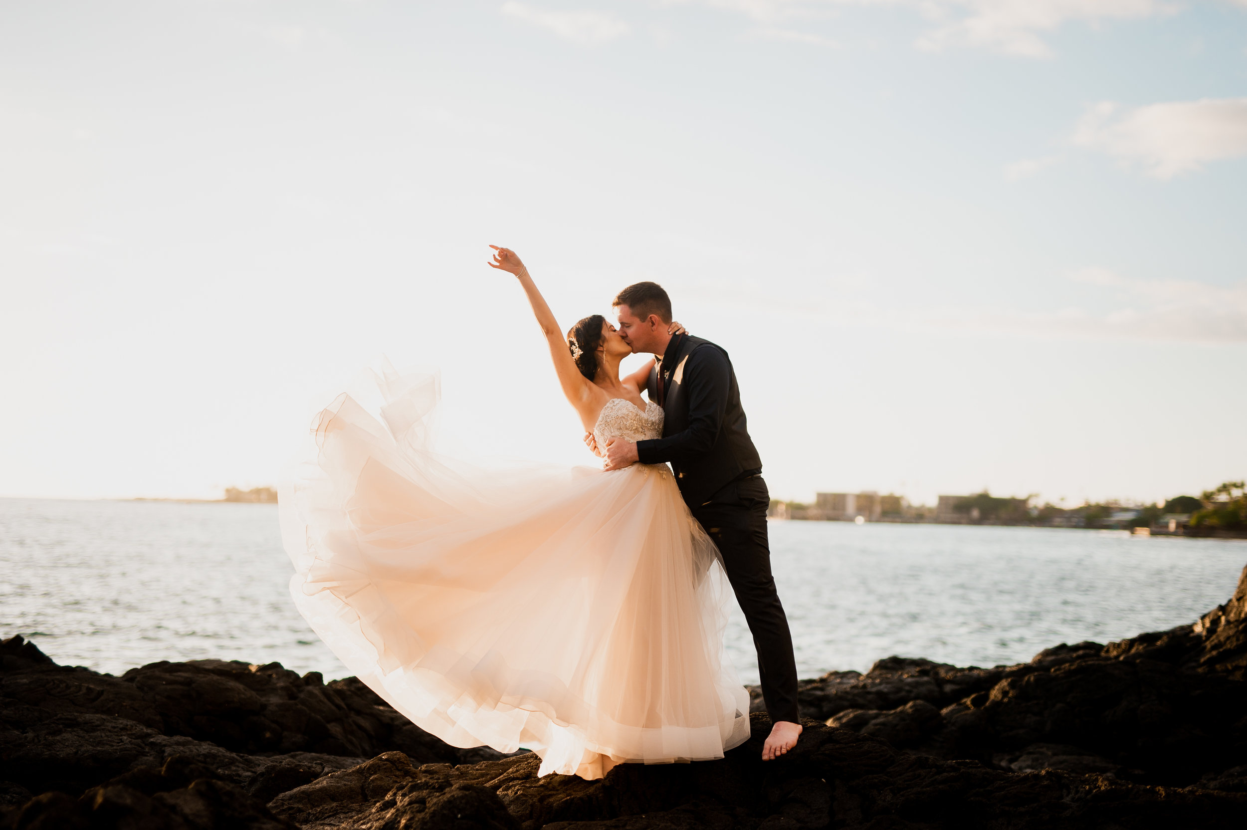 Bride and Groom Kissing on Lava Rocks