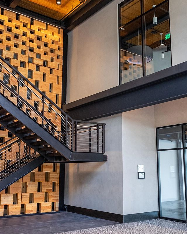 901 E 6th St built by DCA Construction. Features a 2-story bi-food door into the lobby. I had the privilege of working on finishing the walls in the lobby. Had some help from @terrapurallc to get started. Couldn't have done it without him. 📸: @kirstenkaiserphoto .  Finish: Forté Color: Flat Rock . #americanclay #americanclayplaster #interiordesign #homeremodel #commercialdesign