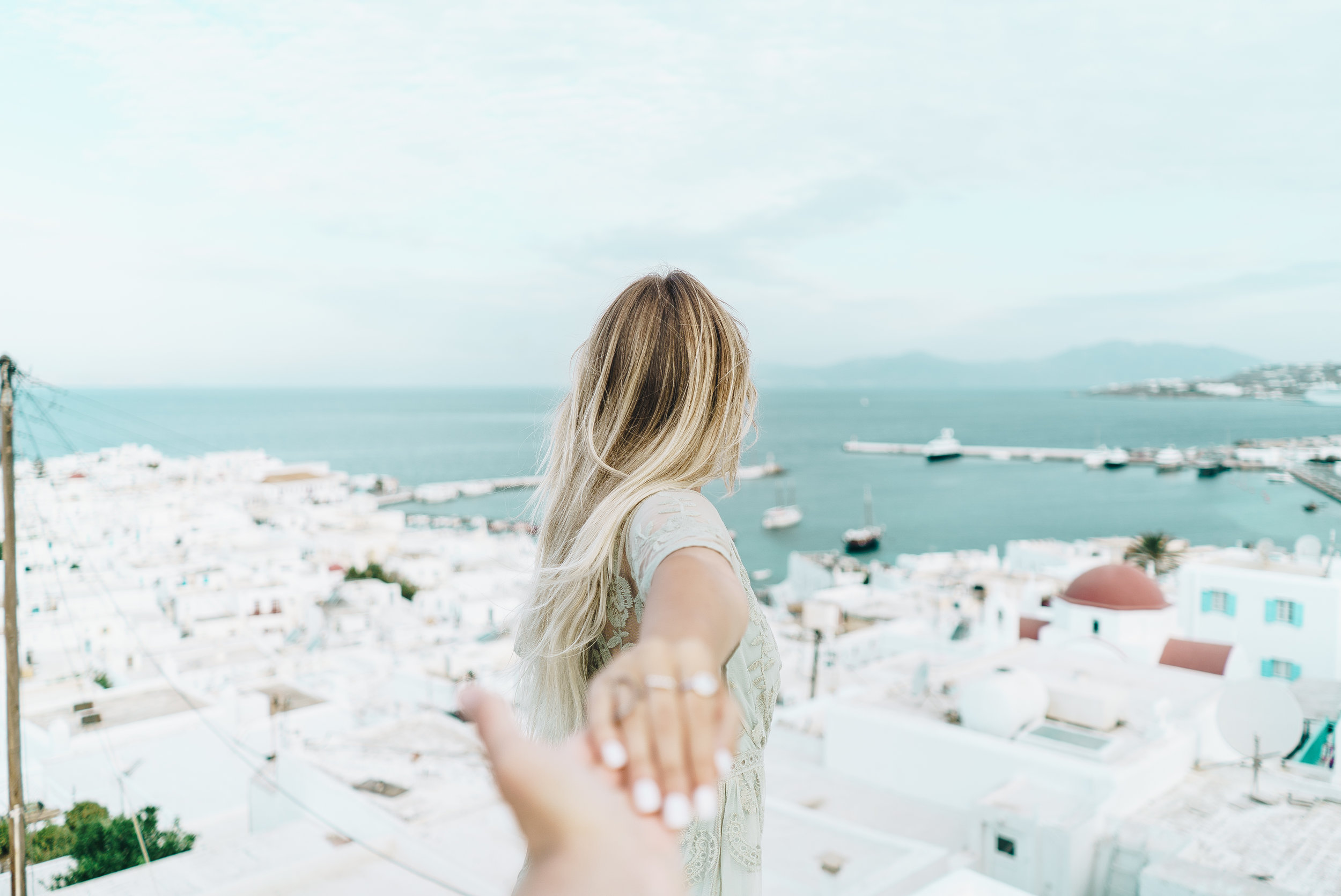 """Most gorgeous view and morning. Kye and I got up early to grab some pictures before the crowds came but everyone on Mykonos are on """"island time"""". Crowds didn't really start to 10am (score!!)."""