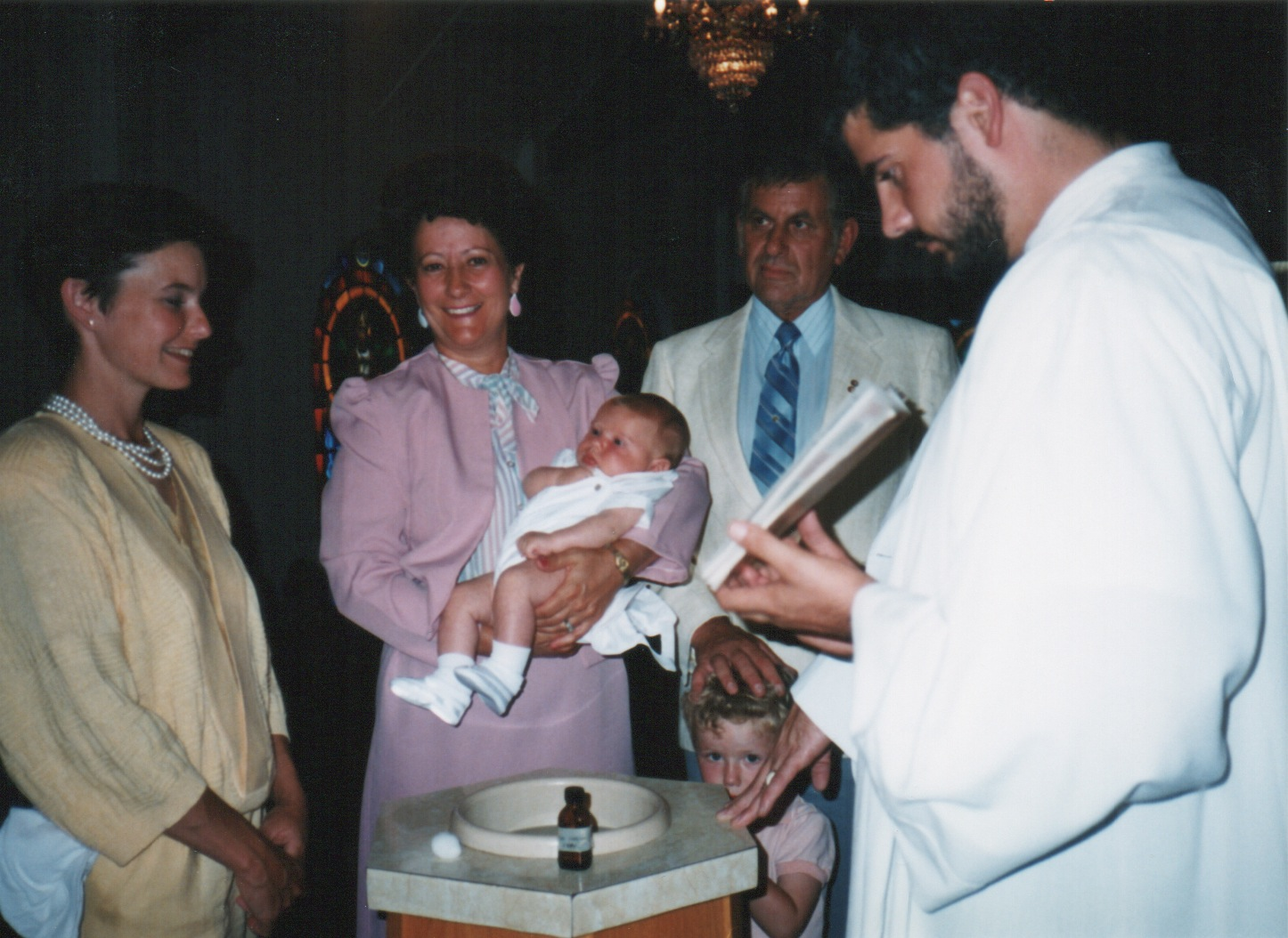 My brother Alex being baptized while my oldest brother Dillon looks cute and my mom (yellow) looks perfect.