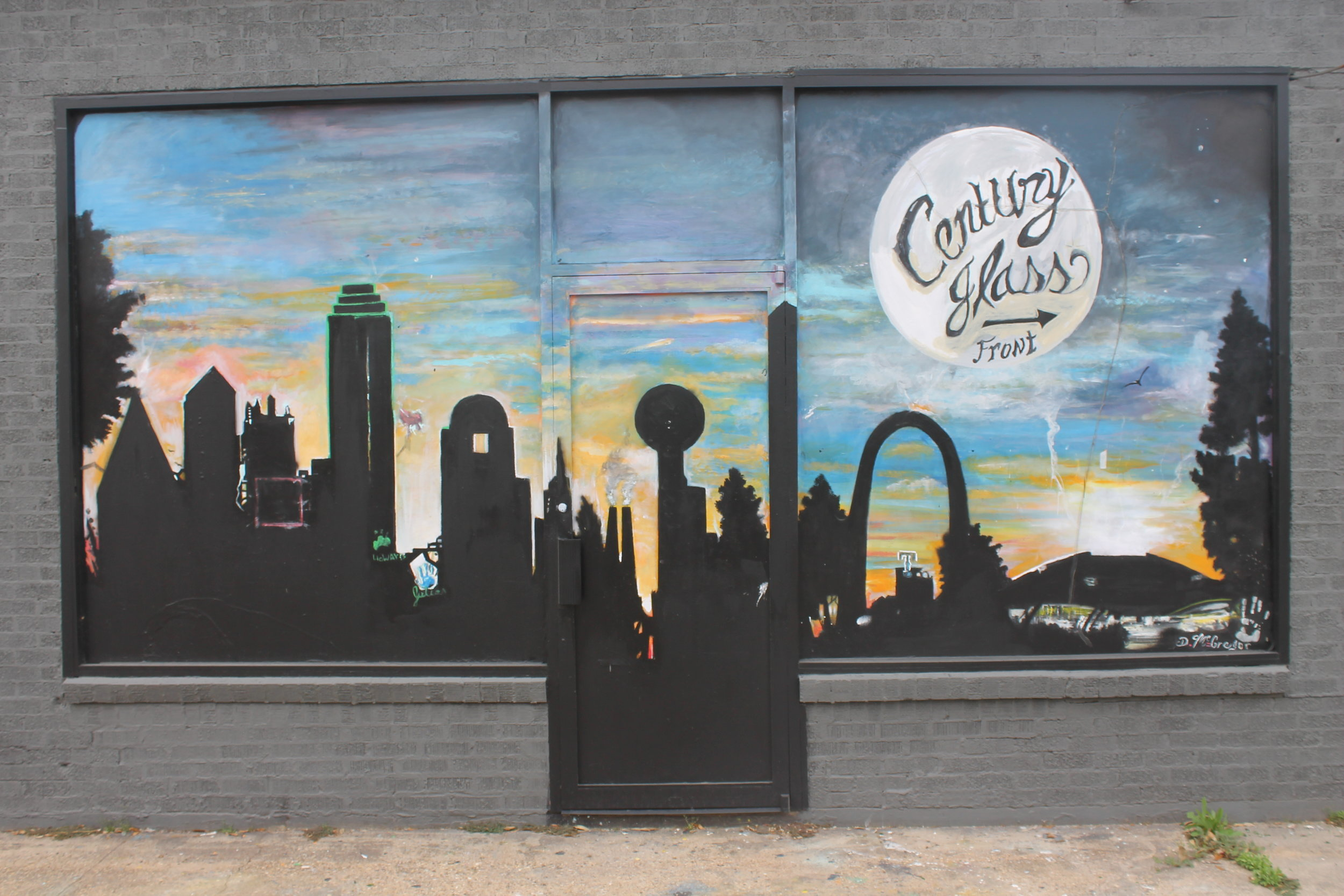 Dallas and outerspace take focus on the mural painted on the Centrury Glass building in Old East Dallas.