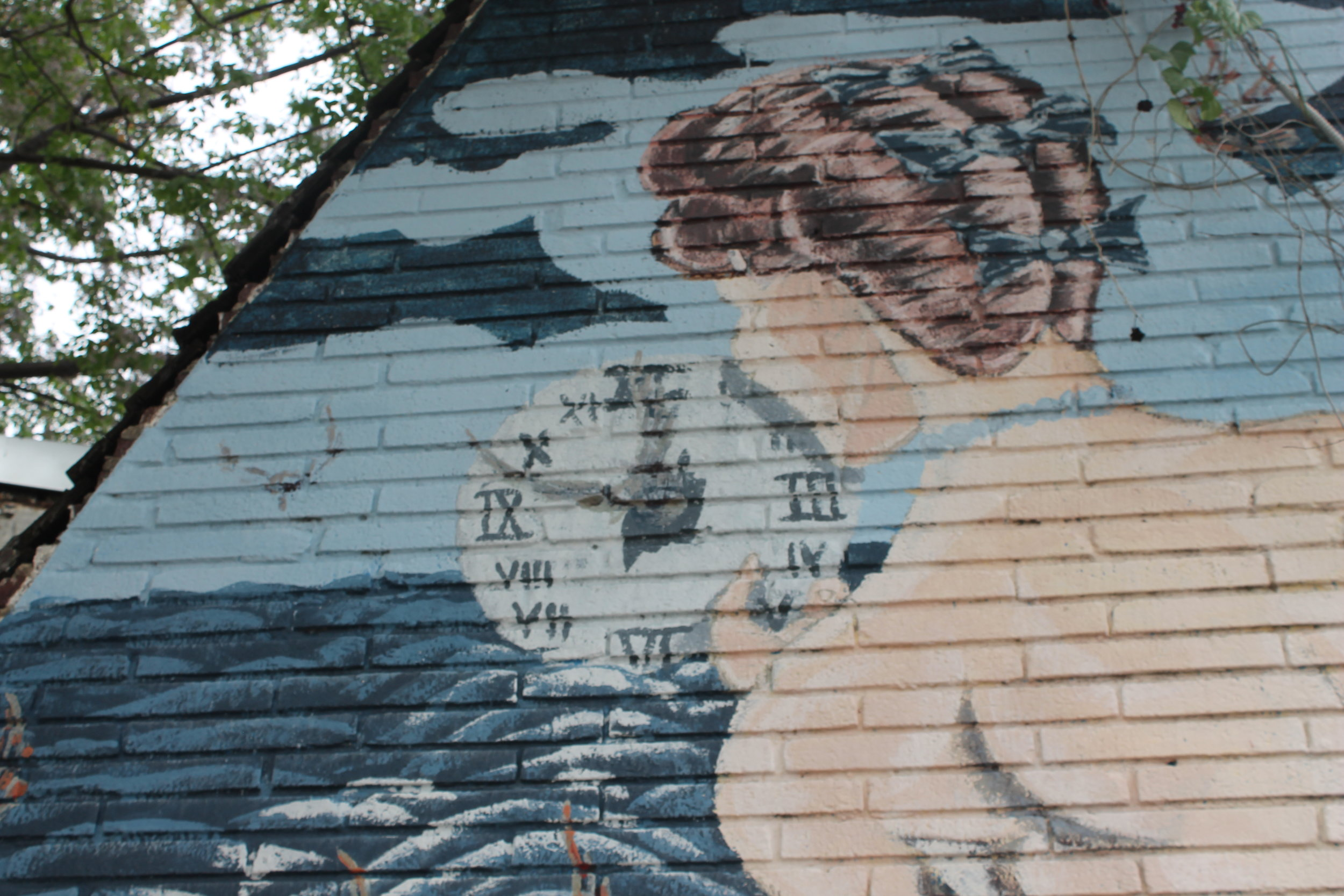 Take an upscale dive under the sea with this mermaid painted outside noted Dallas dive bar Lakewood Landing.