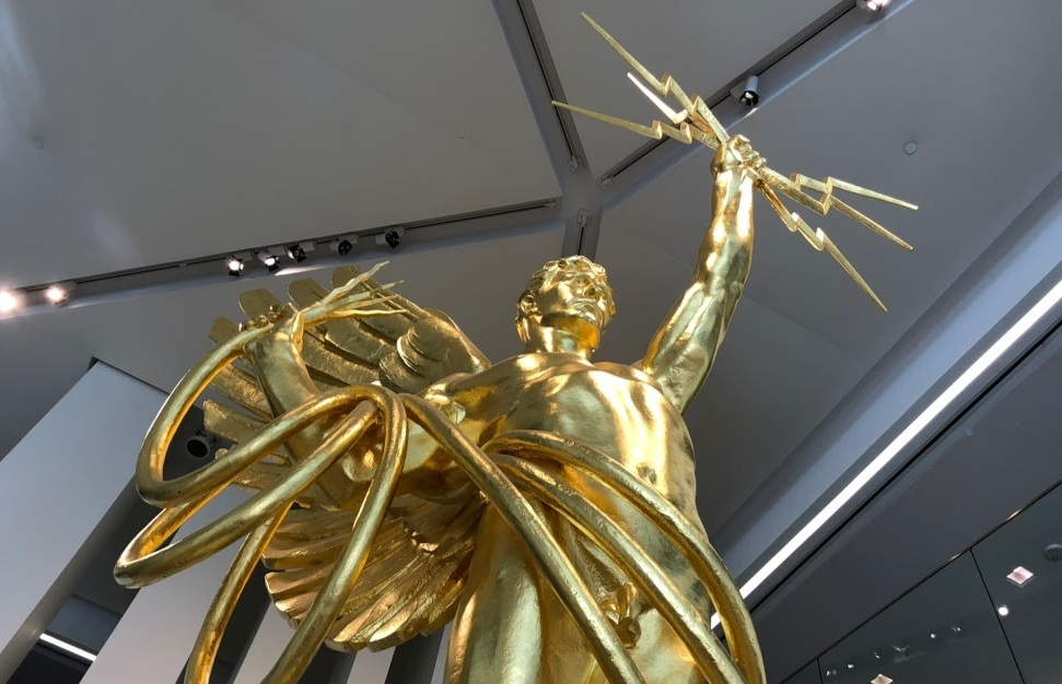 The Golden Boy has stood in downtown Dallas since 2009. It is currently removed from the lobby and will return to the campus in late 2019.