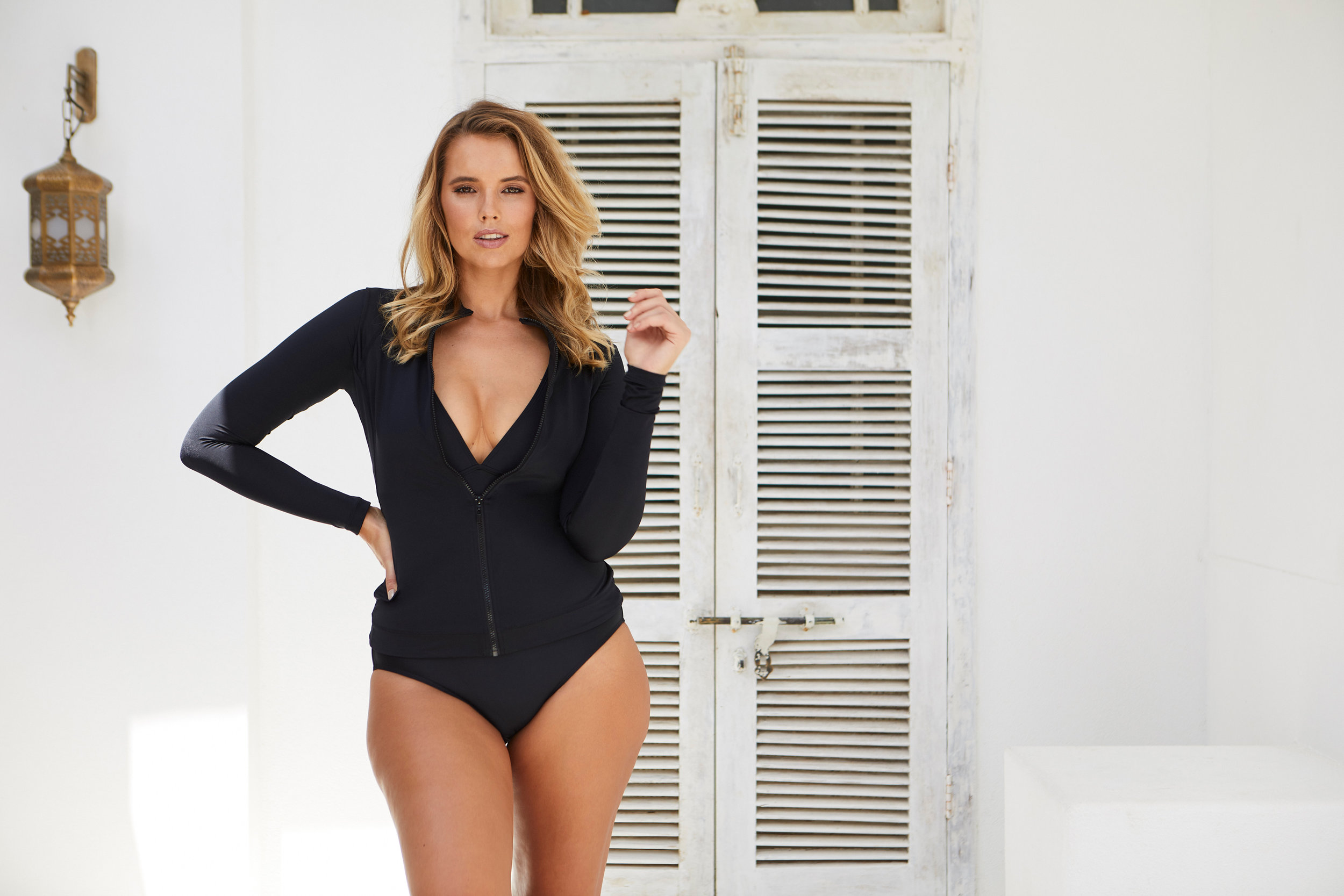 Bree wears the  Original Sexie Rashie Top, $175.00  over the Classic One Piece (coming soon).