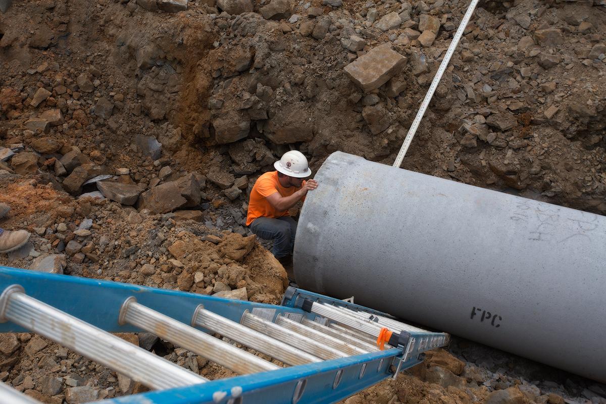 Worker leveling pipe web.jpg