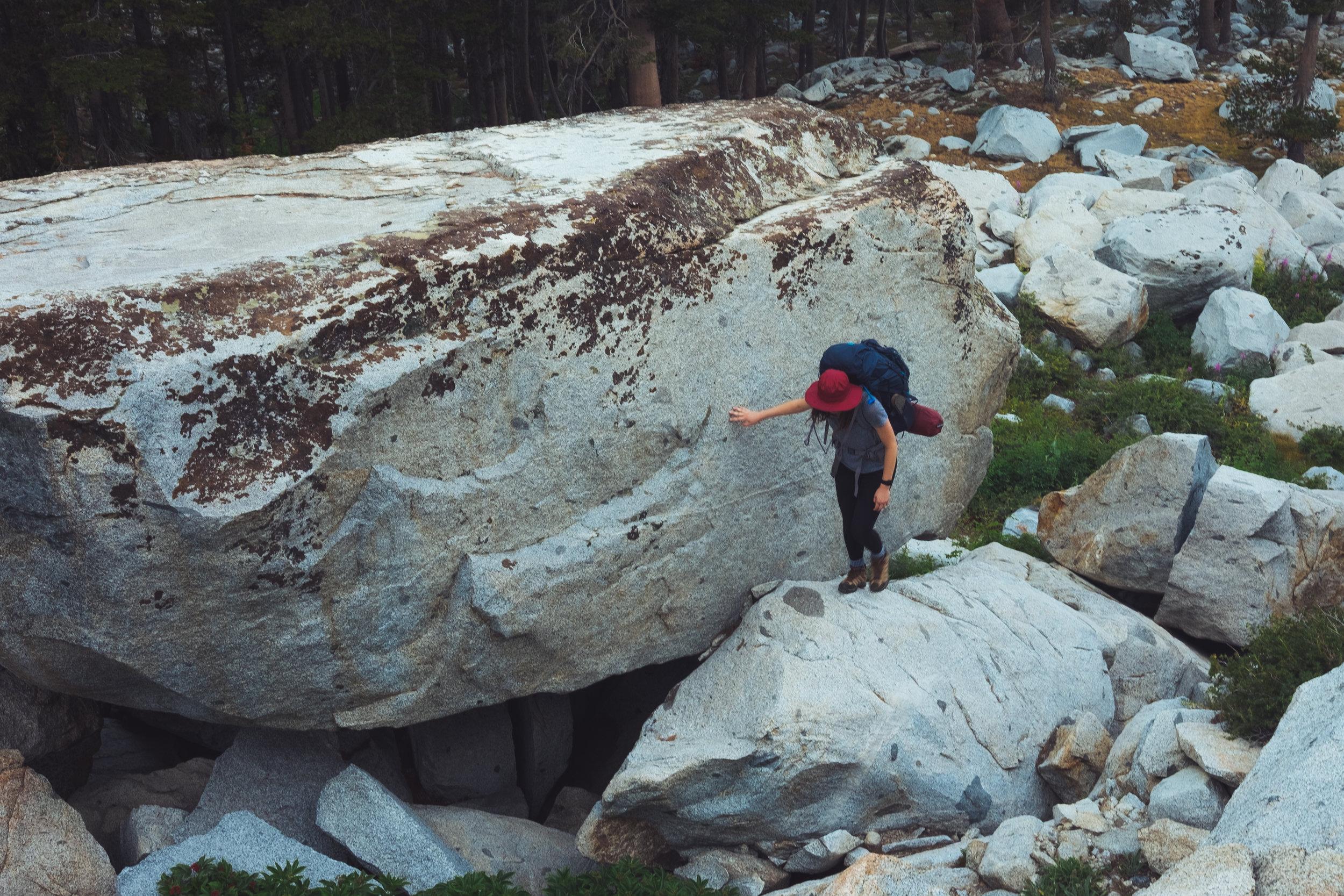emily scrambling on some boulders