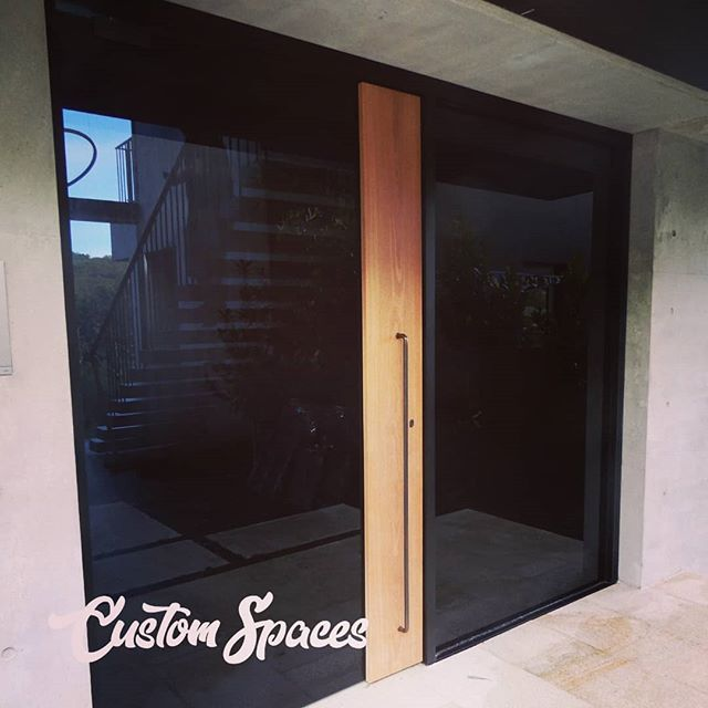 Let's do doors!  Back to manly again, this time it's all about doors 65mm x 285mm spotty gum 2 layers of 6mm laminate toughened glass with a black tint. Final trim still to be installed.
