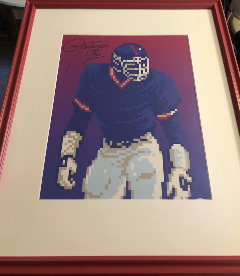 Autographed LT print - LT is royalty in Jersey. Signed and framed Tecmo print of the legend.