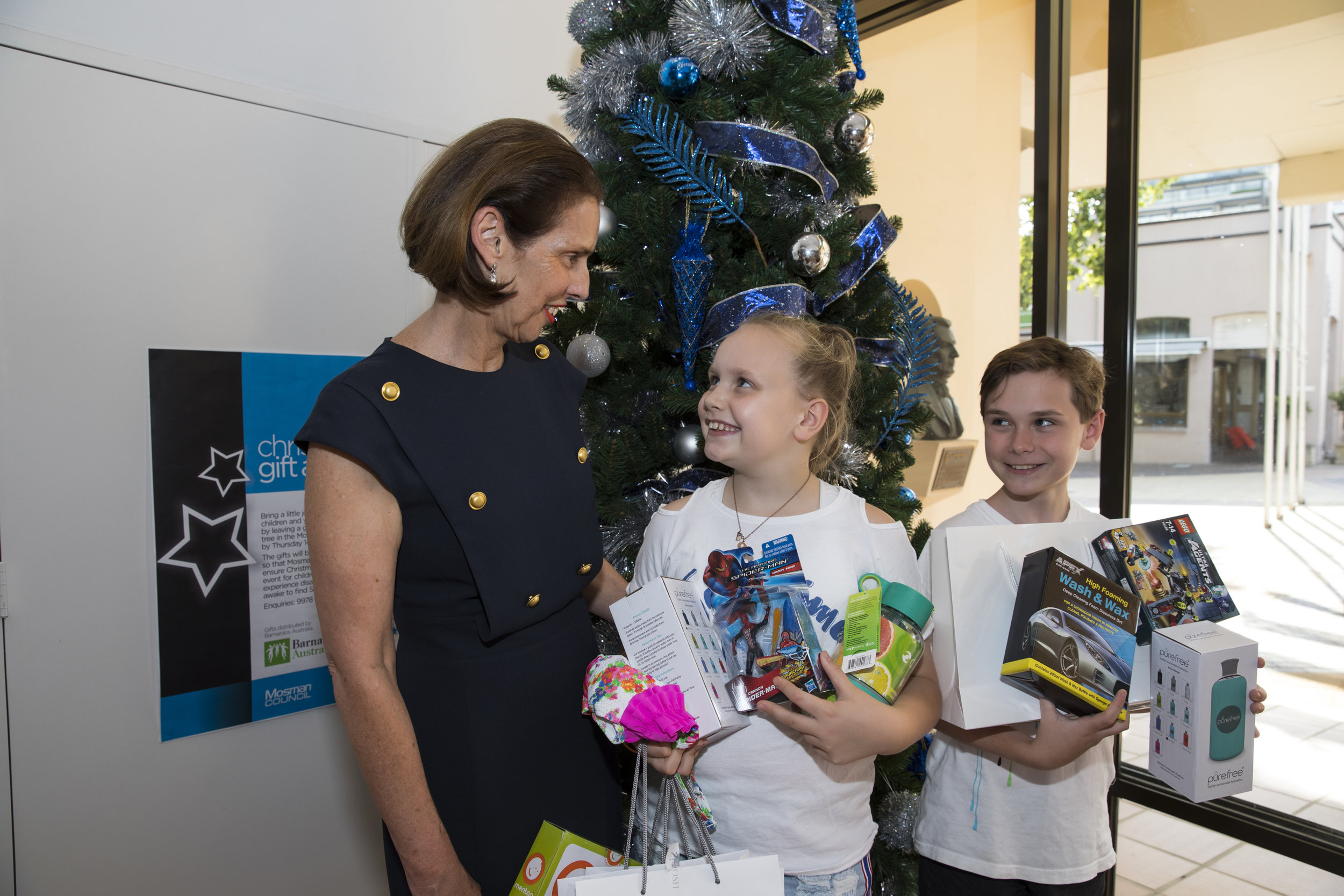 Mosman Mayor Carolyn Corrigan receiving our charity drive gifts from Max and Alexandra Usher.