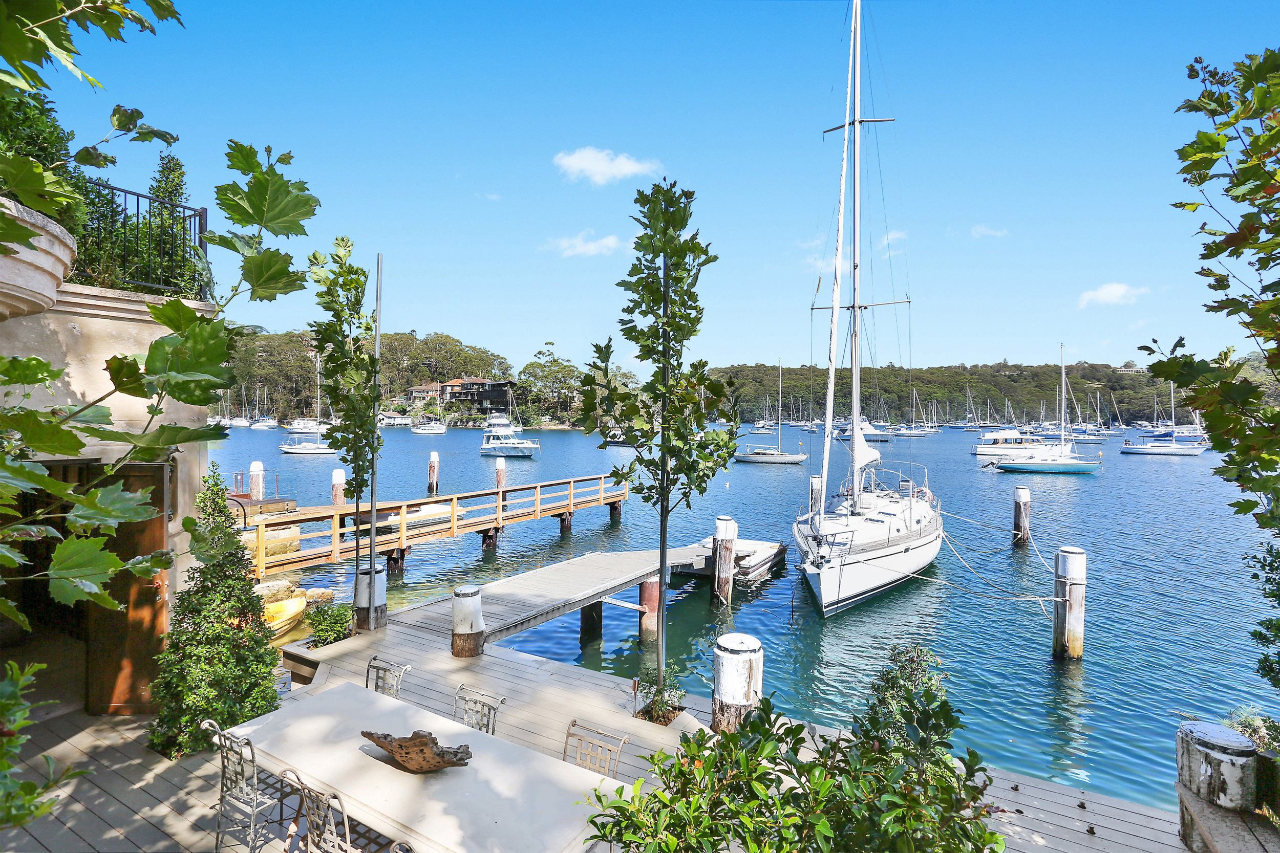A jetty, a pontoon with deep water berthing - and a boathouse also comes with this spectacular home.  Contact:   Michael Coombs/McGrath
