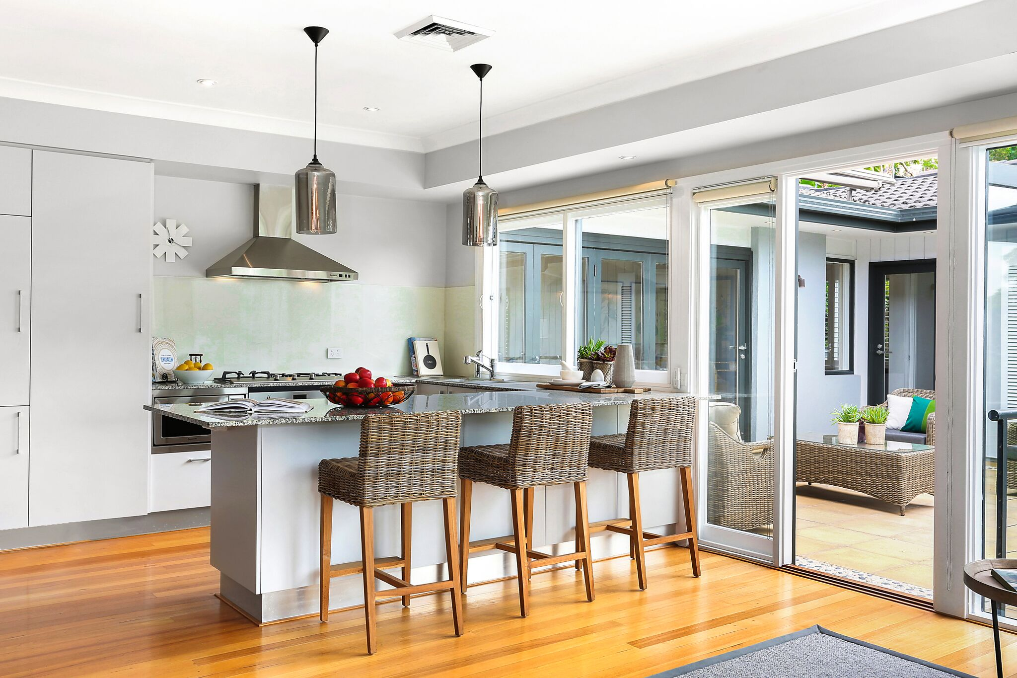 The gourmet, granite crafted, gas kitchen is equipped with premium appliances.