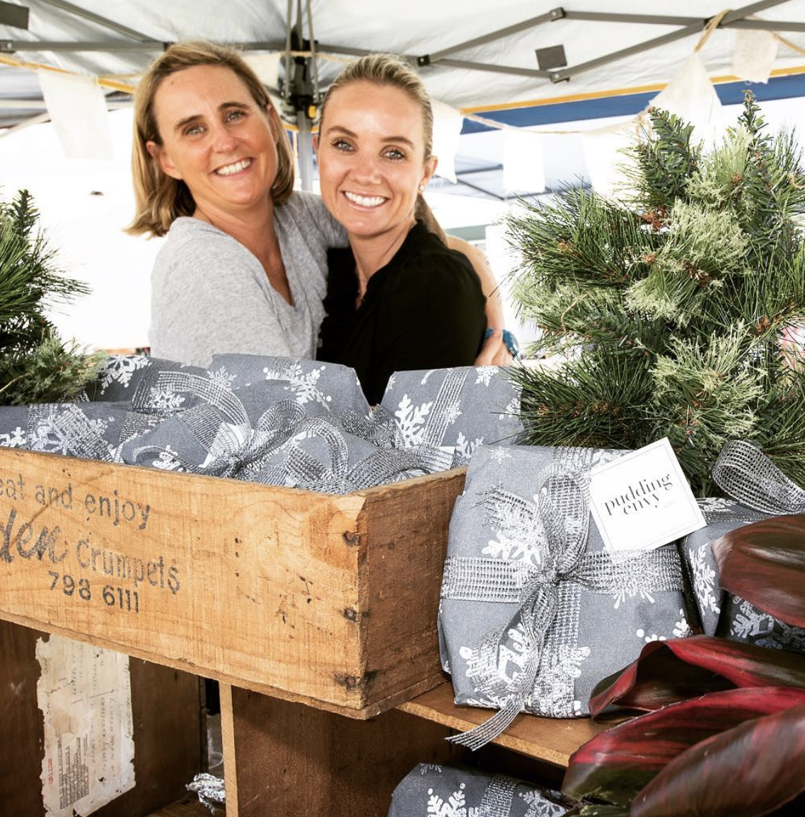 Mel Clark (right) at her sell out Food Envy Christmas Pudding stall in Mosman.